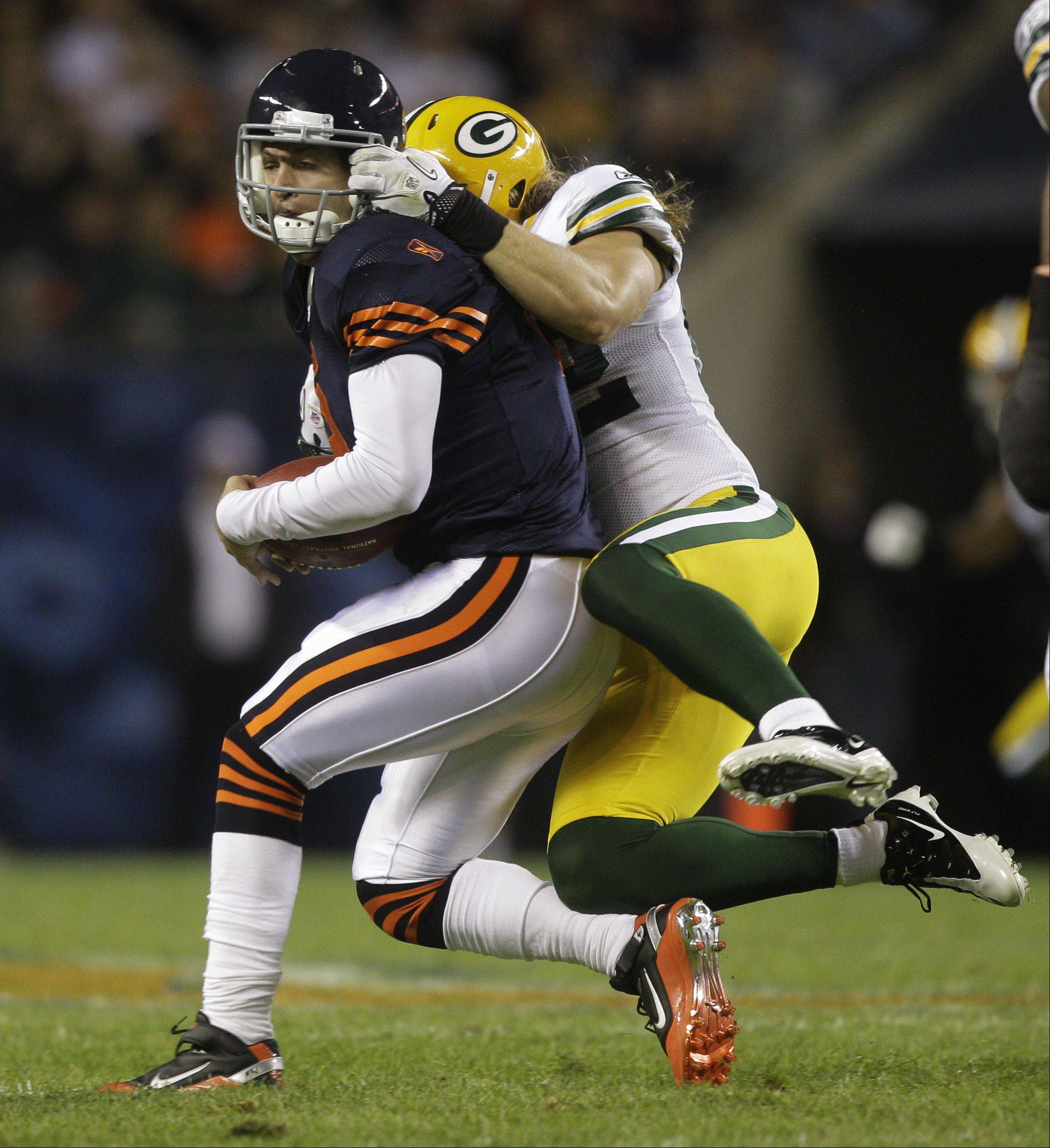 Bears quarterback Jay Cutler (6) is tackled by Green Bay Packers linebacker Clay Matthews during the first half of an NFL football game Monday, Sept. 27, 2010, in Chicago. Matthews was called for a facemask penalty on the play.