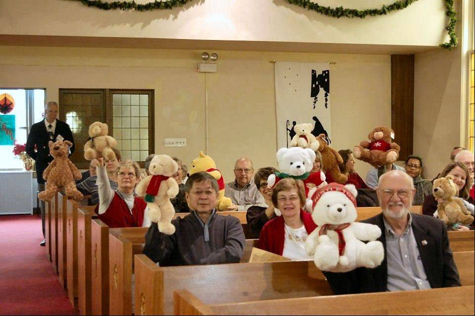 Teddy bears share the pews with members of St. Paul United Church of Christ in Barrington.