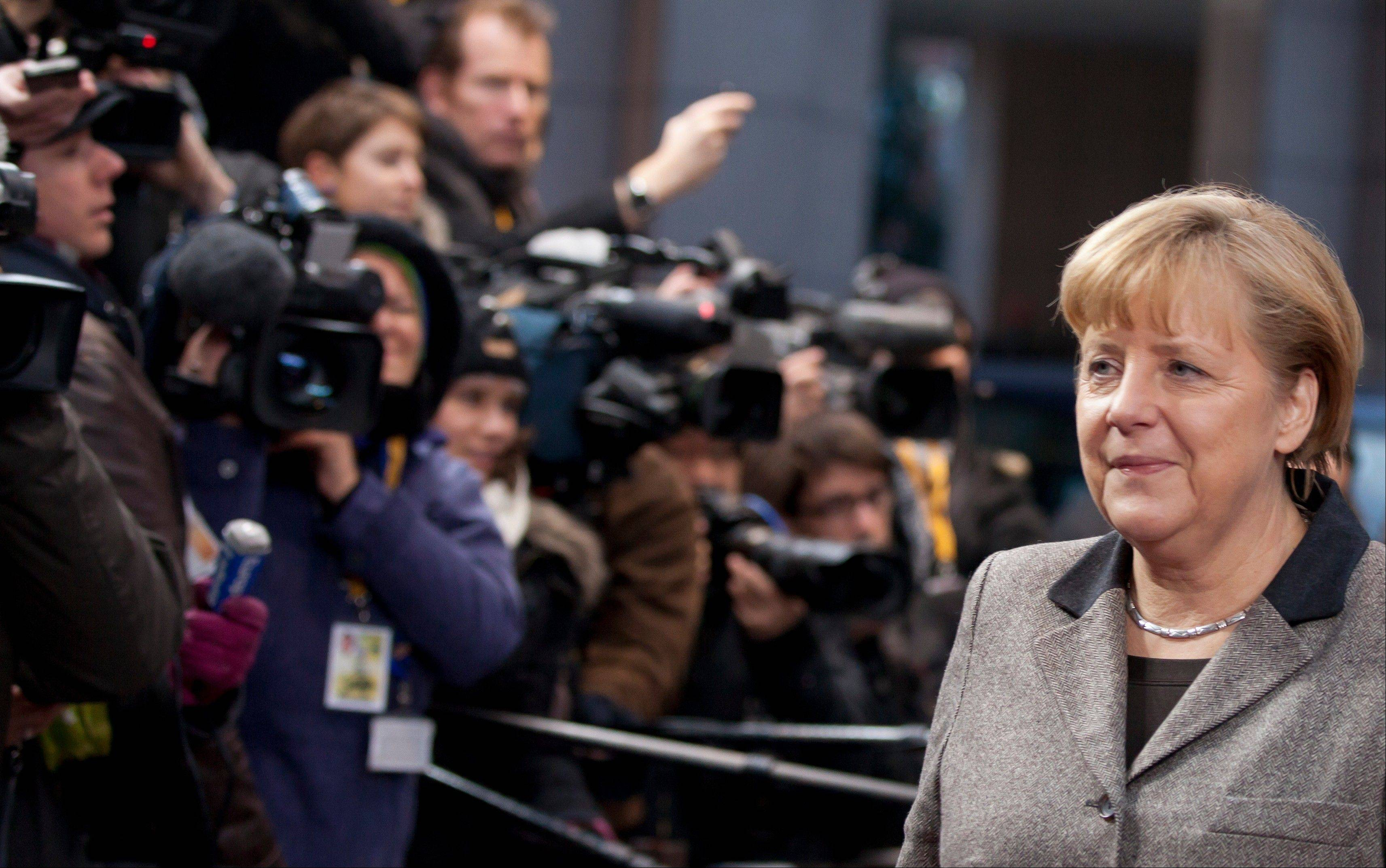 German Chancellor Angela Merkel arrives for an EU summit in Brussels Thursday. Member nations agreed on the foundation of a fully-fledged banking union and Greece�s euro partners approved billions of euros in bailout loans that will prevent the nation from going bankrupt.