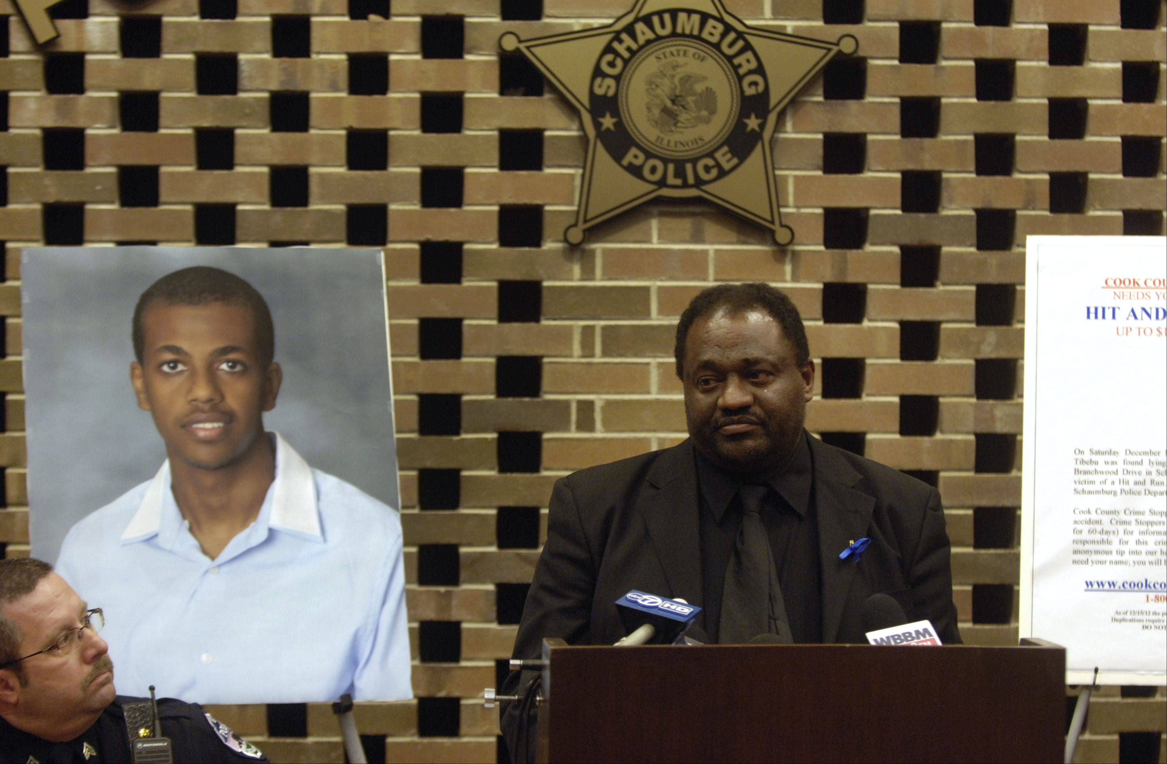 Tefera Beyene appeals to the person whose vehicle struck his son, Mikias Tibebu, to come forward. At left is Schaumburg police Sgt. John Nebl.