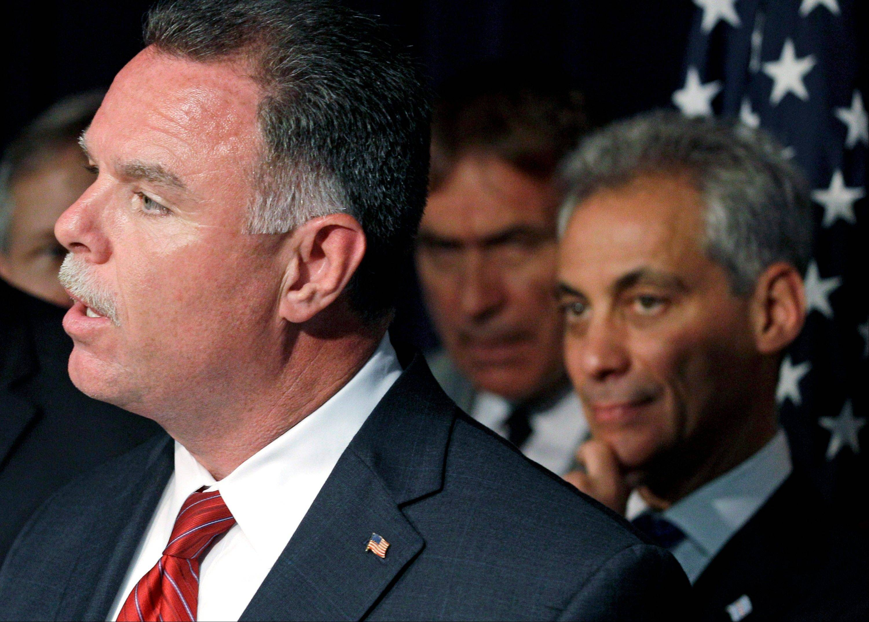 Police Superintendent Garry McCarthy, left, and Chicago Mayor Rahm Emanuel, rear, appear during a June news conference in Chicago. Emanuel has made it clear he was ready to face off with the gun lobby.