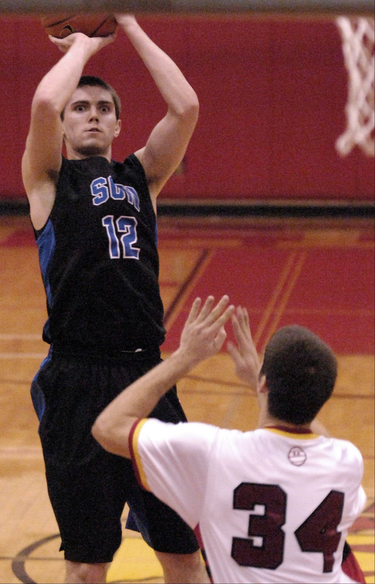 St. Charles North's Quinten Payne shoots and scores from the outside against Batavia during Thursday's game at Batavia.