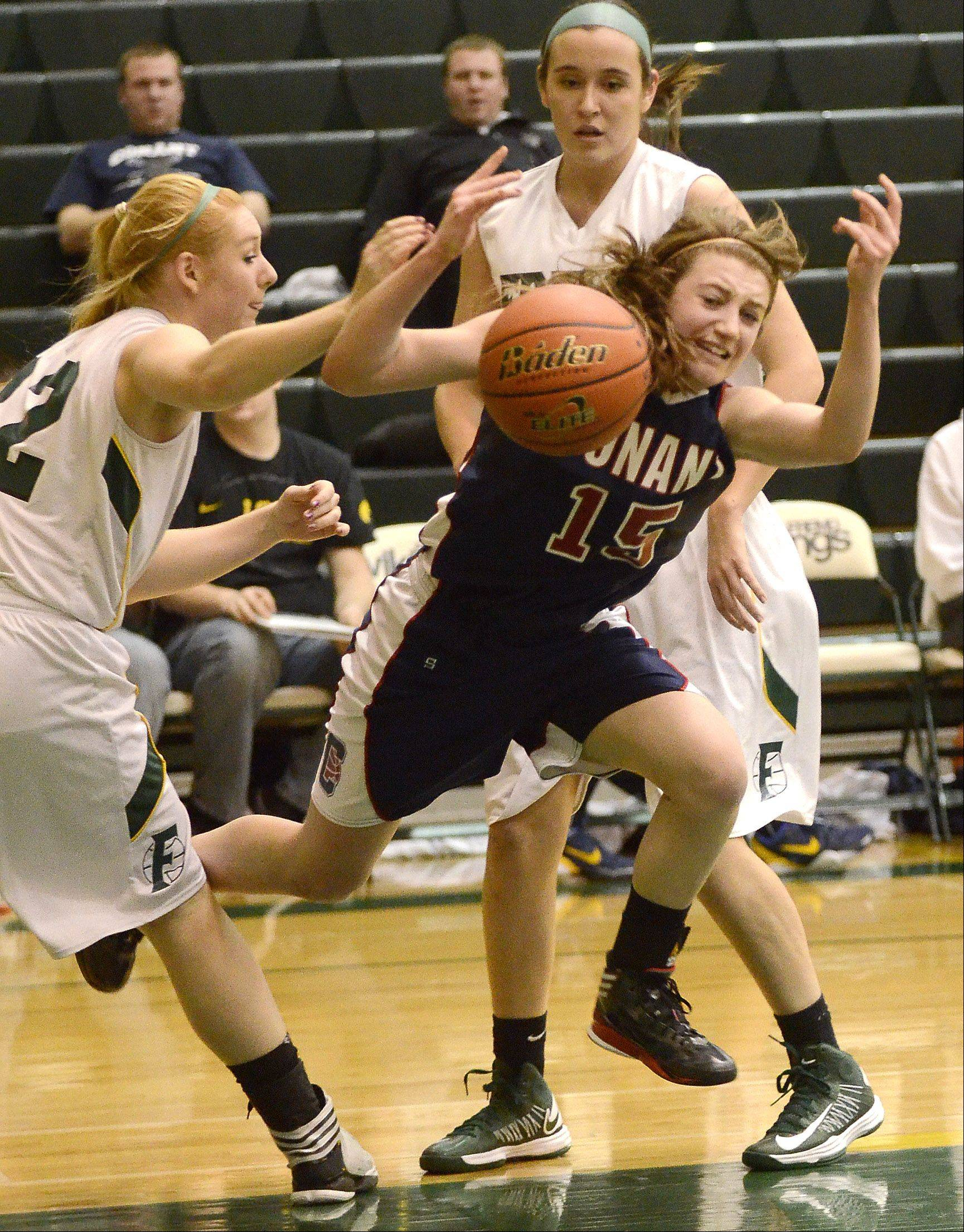Fremd�s Sydney Sek fouls Conant�s Lexi Zades (15) during Thursday night�s MSL West game in Palatine.