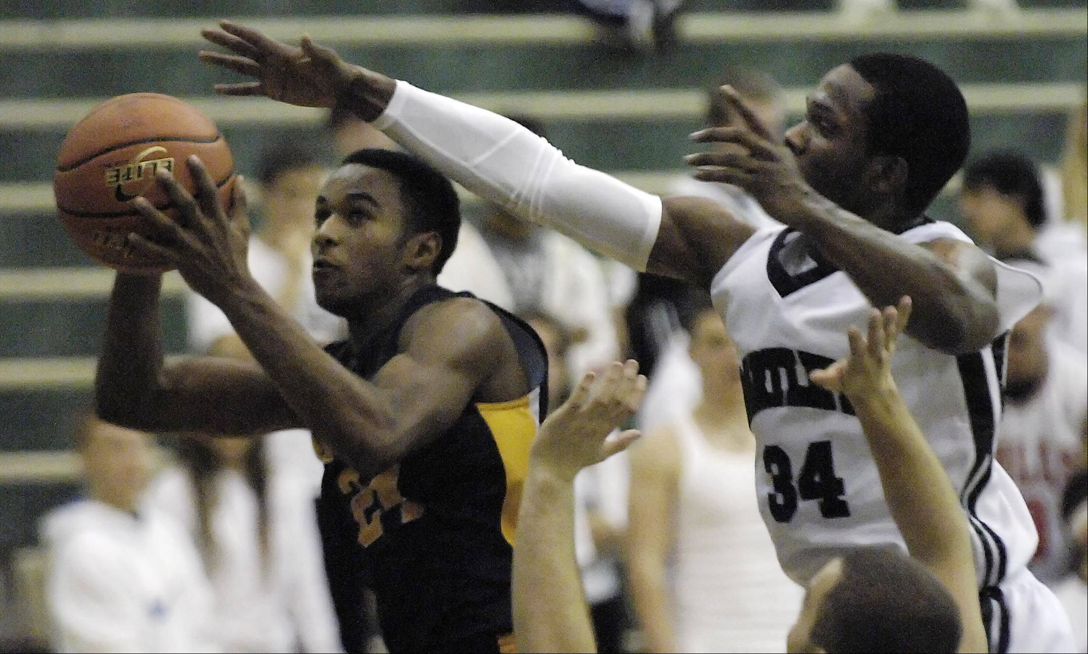 Neuqua Valley's Jabari Sandifer is fouled by Bartlett's Lance Whitaker .