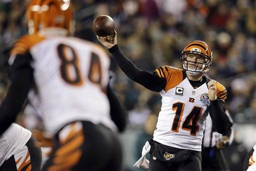 Andy Dalton threw a touchdown pass and ran for another score, an opportunistic defense forced five turnovers and Cincinnati beat the Philadelphia Eagles 34-13 on Thursday night. The Bengals (8-6) took a half-game lead over the Pittsburgh Steelers (7-6) for the last playoff spot in the AFC. But their game at Pittsburgh next week is far more important in the standings than this one.