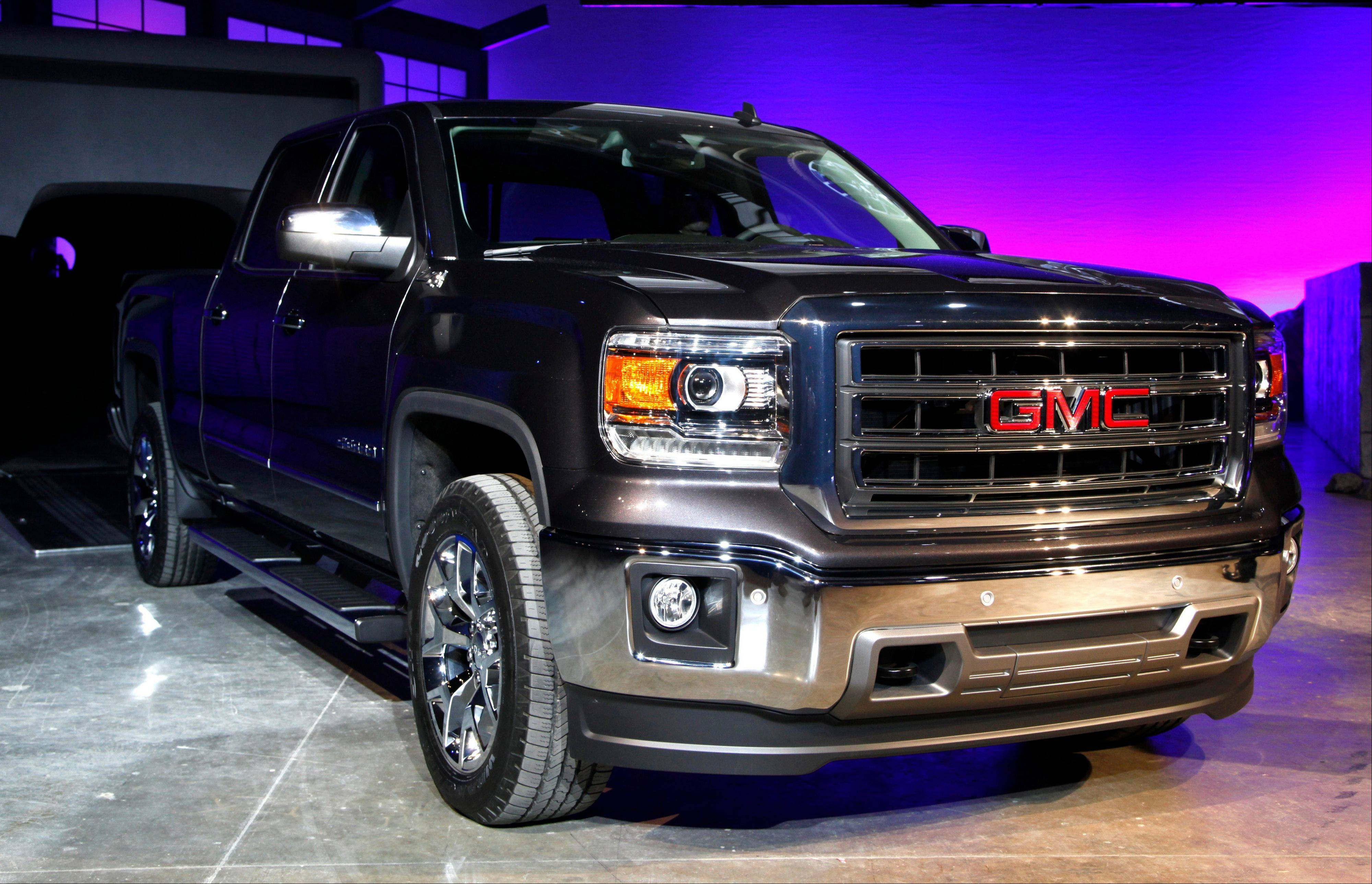 The 2014 GMC Sierra debuts in Pontiac, Mich., Thursday, Dec. 13, 2012. General Motors unveiled a new versions of its top-selling Chevrolet Silverado and GMC Sierra on Thursday Dec. 13, 2012. The 2014 models will go on sale by early spring or late summer. The models roll into a market where truck sales are growing after a five-year slump.