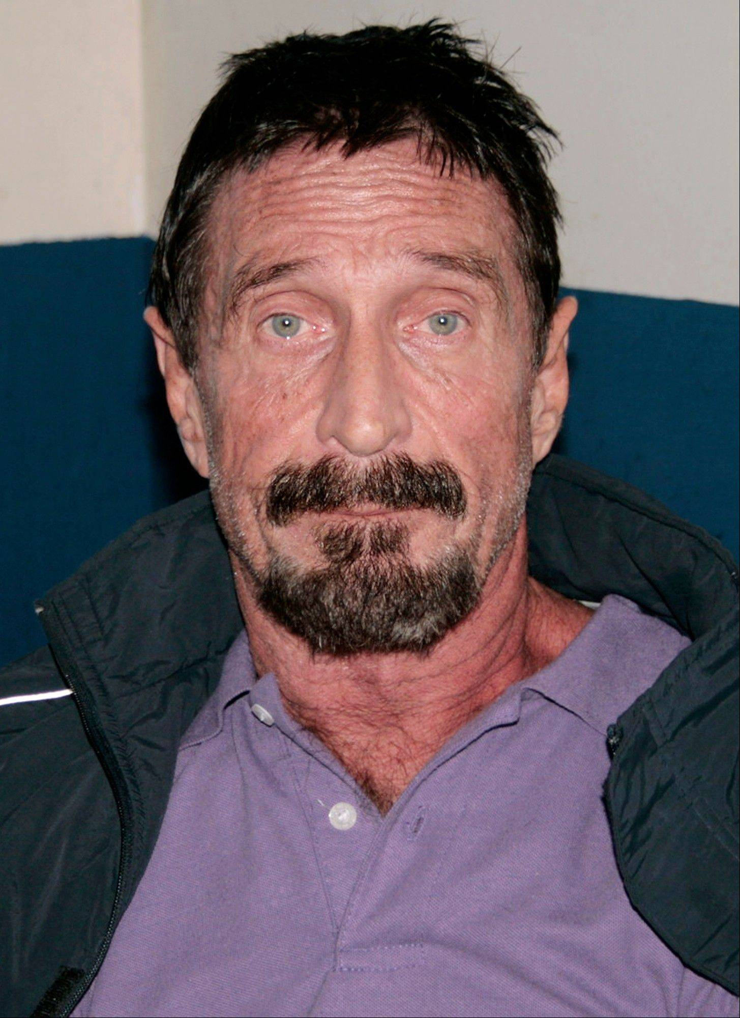 Software company founder John McAfee is photographed in an immigration detention center in Guatemala City, Thursday, Dec. 6, 2012.