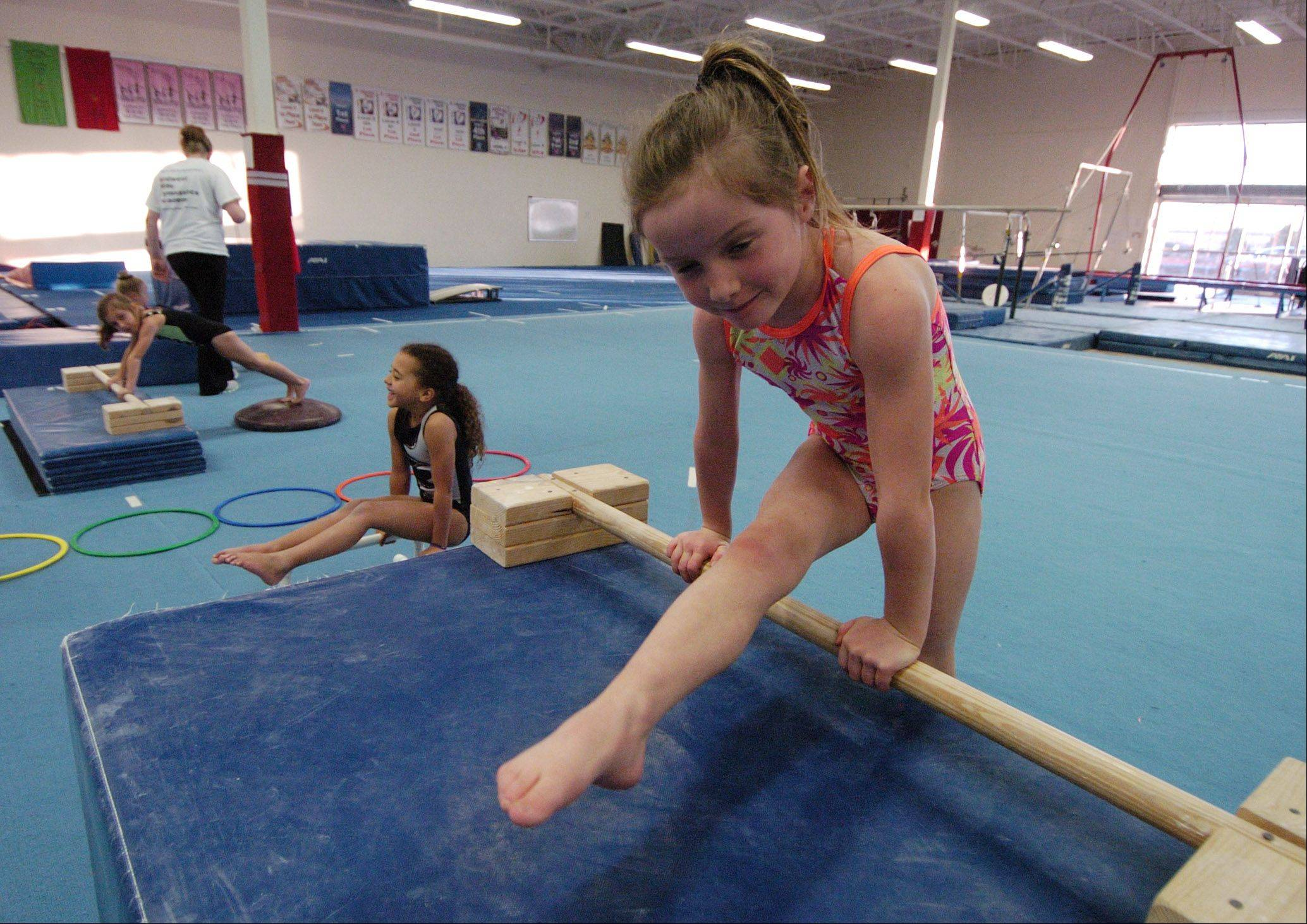 Sophia Goluba, 6, of Schaumburg practices at Midwest Elite Gymnastics Academy in South Barrington. The academy will be moving to Elgin in January.