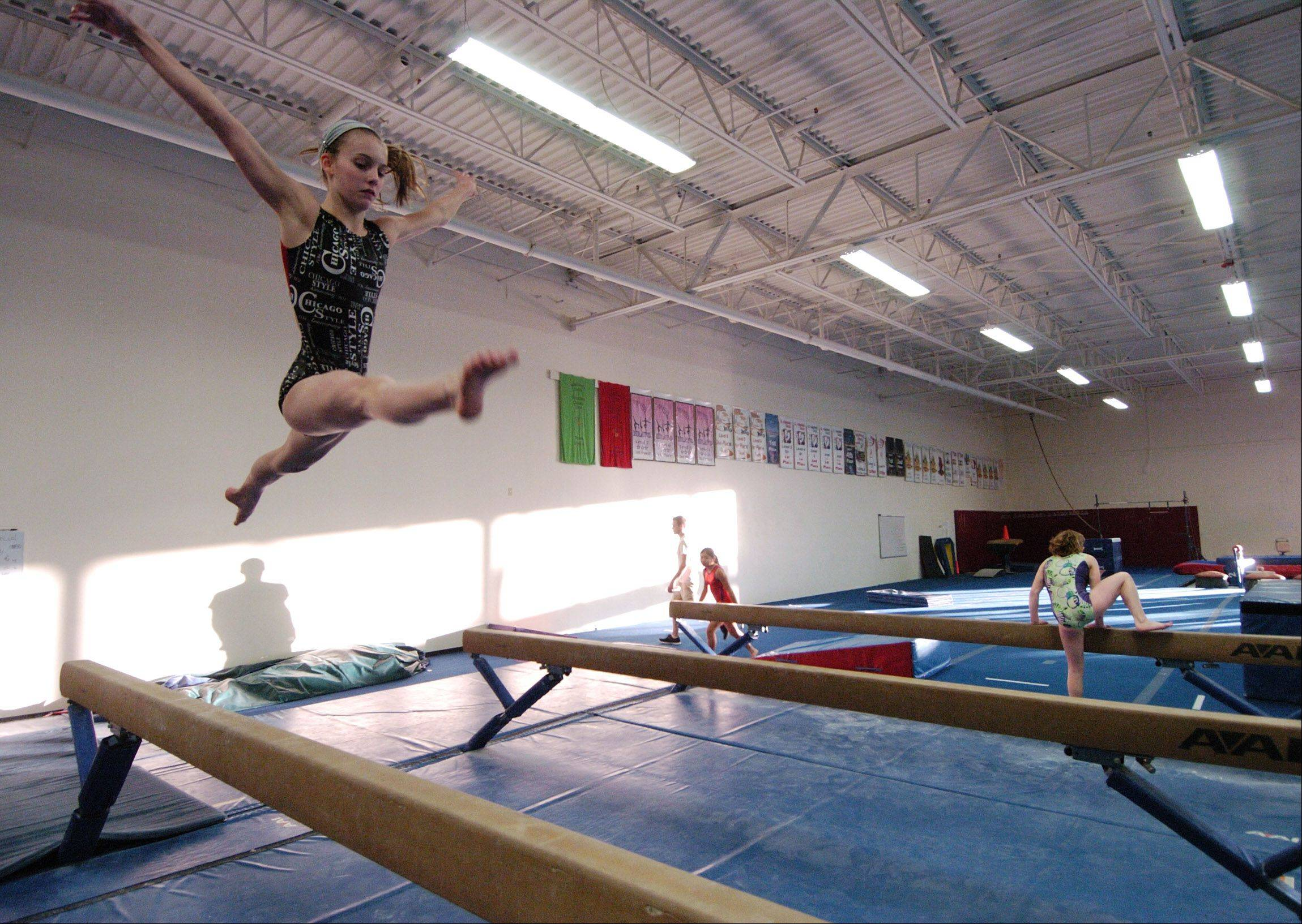 Ashley Suchyta, 13, of Barrington practices on the balance beam at Midwest Elite Gymnastics Academy in South Barrington. The academy will be moving to Elgin in January.