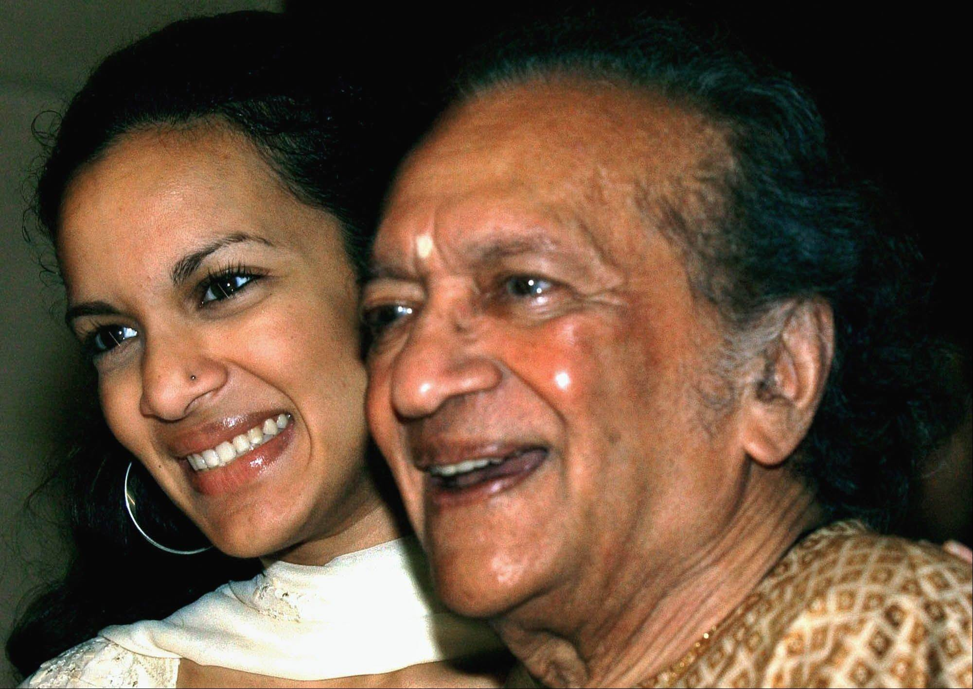 In this Dec. 19, 2002, Indian Sitar maestro Ravi Shankar, right, and daughter Anoushka Shankar smile during a press conference in Calcutta, India. Shankar, the sitar virtuoso who became a hippie musical icon of the 1960s after hobnobbing with the Beatles and who introduced traditional Indian ragas to Western audiences over an eight-decade career, has died. He was 92.
