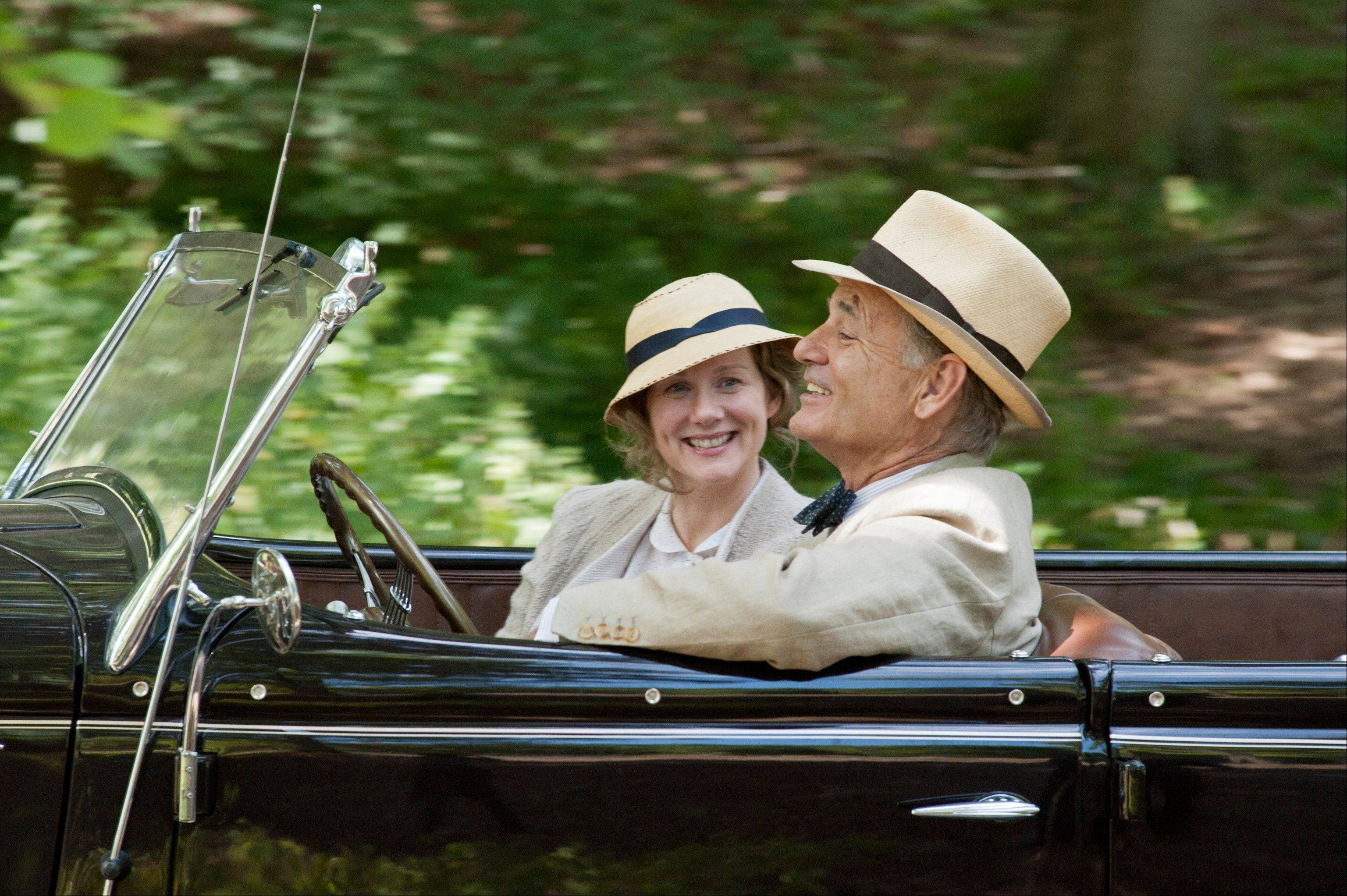 "Daisy (Laura Linney) accompanies her cousin President Franklin D. Roosevelt (Bill Murray) on a drive in the historical drama ""Hyde Park on Hudson."""