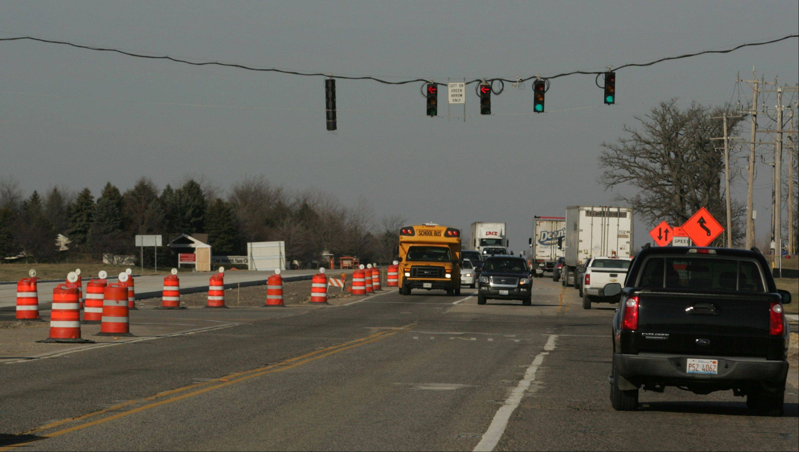 Traffic moves through the construction zone at the Route 47 and Interstate 90 interchange in Huntley. Nearly 1,000 residents from the neighboring Sun City subdivision have asked the Illinois Tollway Authority to put up a sound barrier between Sun City and the tollway. Residents are upset about traffic noise and say it has disrupted their quality of living.