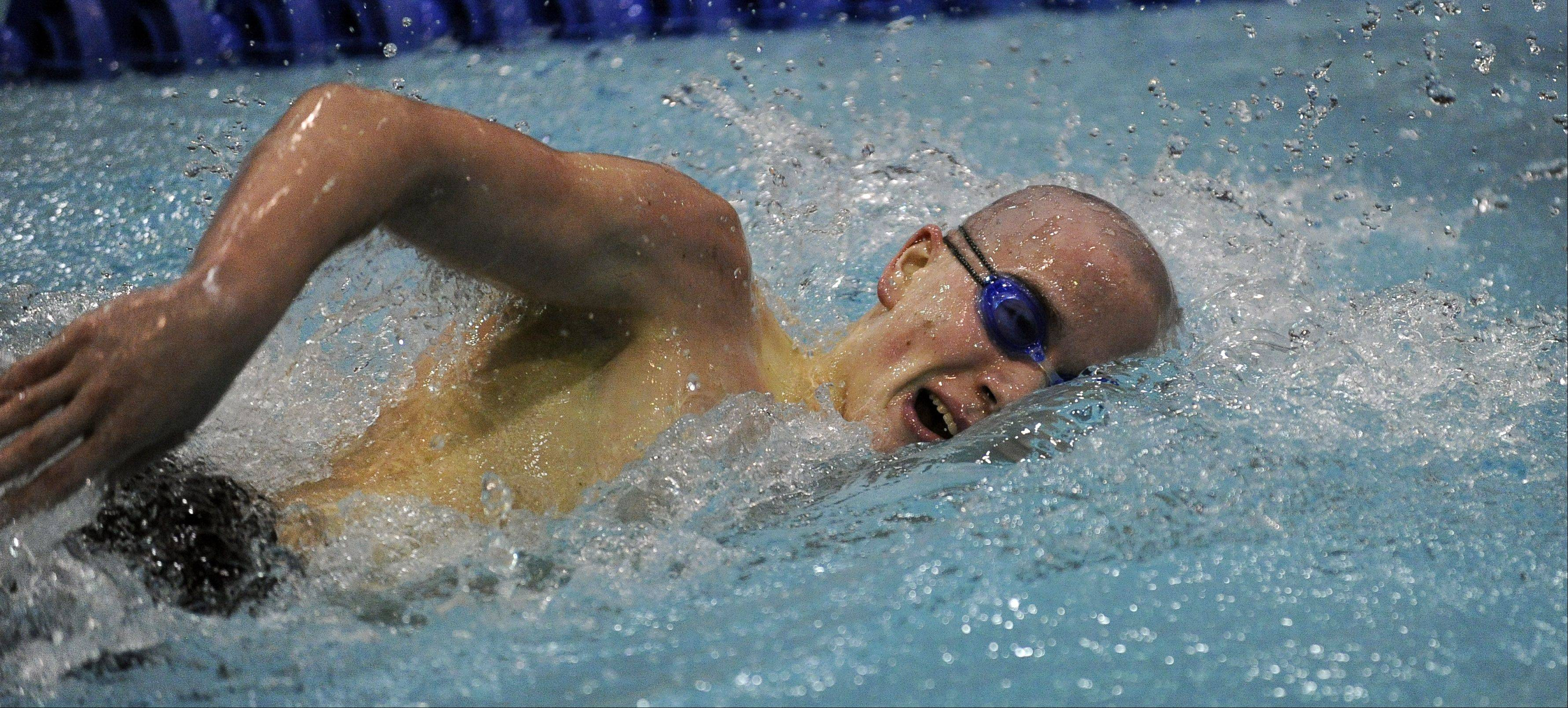 Conant's Jon Burke powers ahead in the 500-yard freestyle in the state swimming preliminaries at Evanston last season. He qualified for the finals and finished fifth.