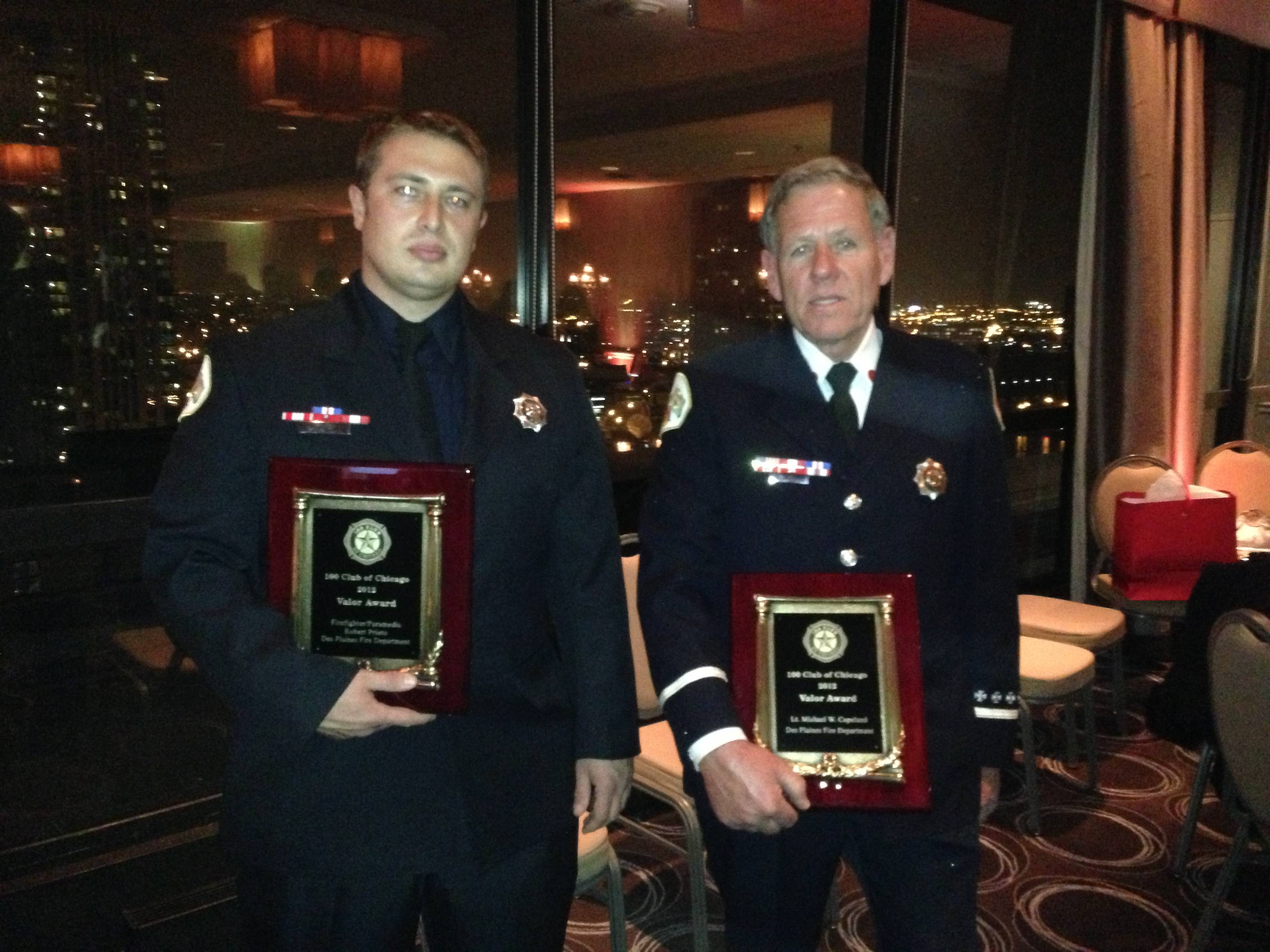 Firefighter/Paramedic Robert Prieto, left, and Retired Fire Lieutenant Michael Copeland of the Des Plaines Fire Department display their Awards of Valor following the 100 Club of Chicago's Valor Awards Ceremony, November 8, 2012, in the ballroom of the Holiday Inn Mart Plaza in Chicago.  The firefighters received the award for their selfless actions under great personal risk in saving a child and his grandmother from a basement fire in December 2011.