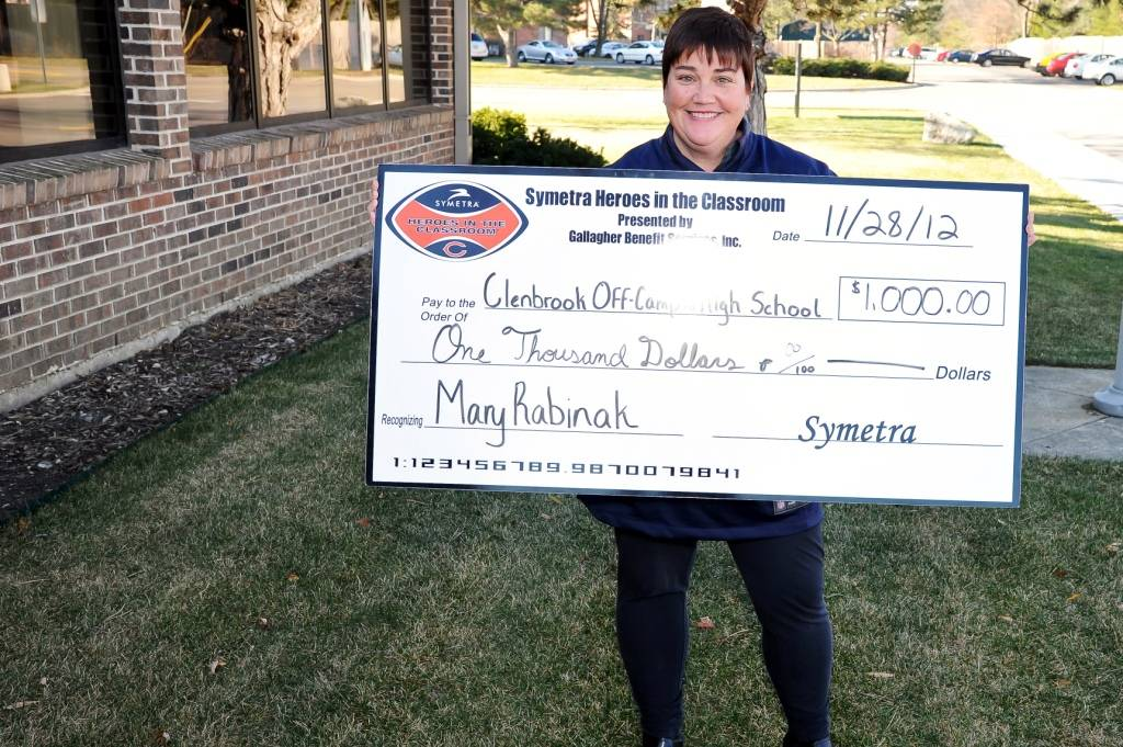 "Glenbrook Off-Campus High School teacher Mary Rabinak displays Symetra's donation to the school, made in recognition of her ""Symetra Hero in the Classroom"" teaching honor."