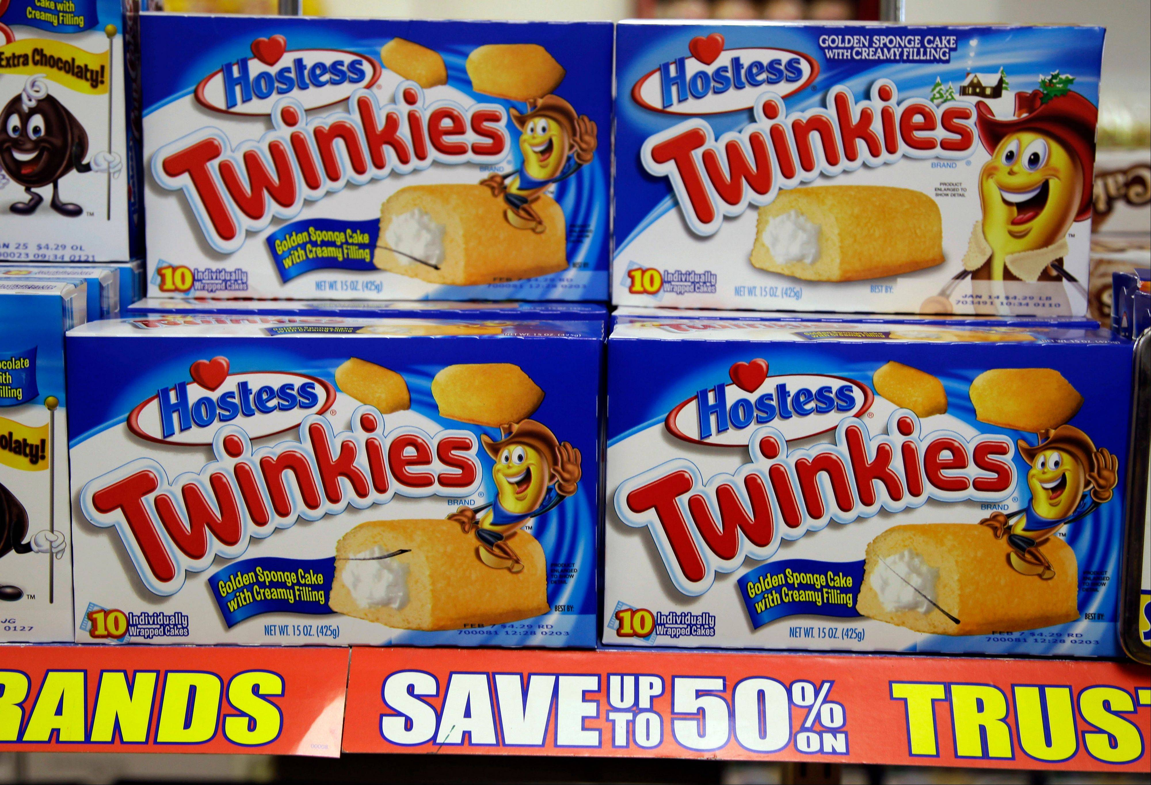 Wal-Mart Stores Inc. and Kroger Co. are among the bidders for assets being sold by Hostess Brands Inc., the bankrupt maker of Wonder bread and Twinkies, said a person familiar with the matter.