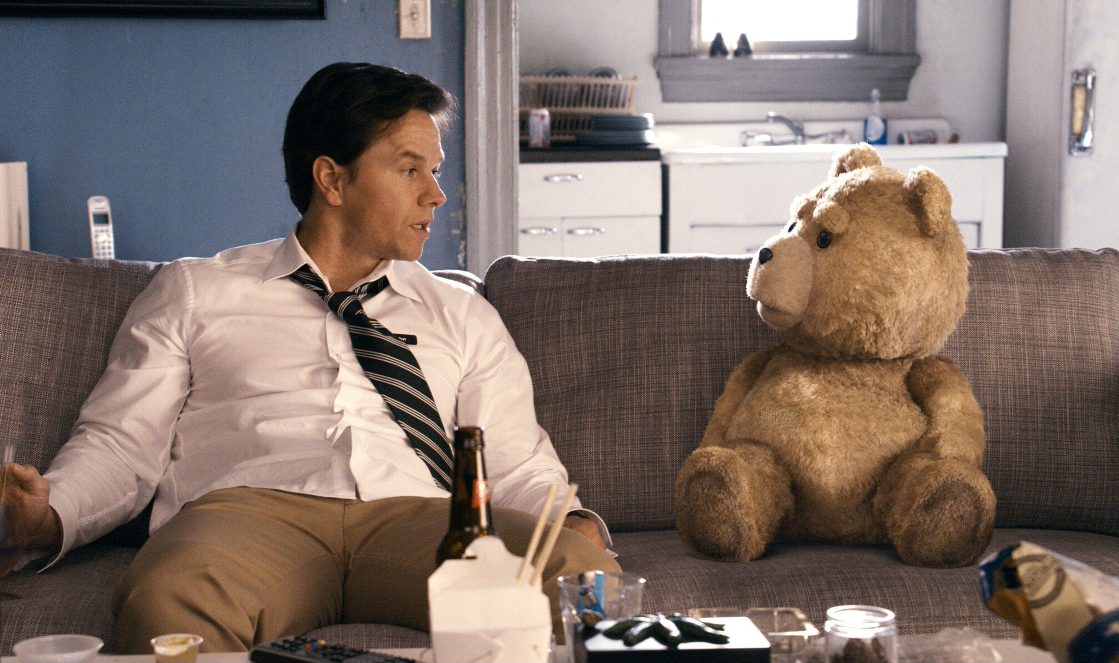 "John (Mark Wahlberg) spends time with his talking stuffed bear (voiced by Seth MacFarlane) in ""Ted."""