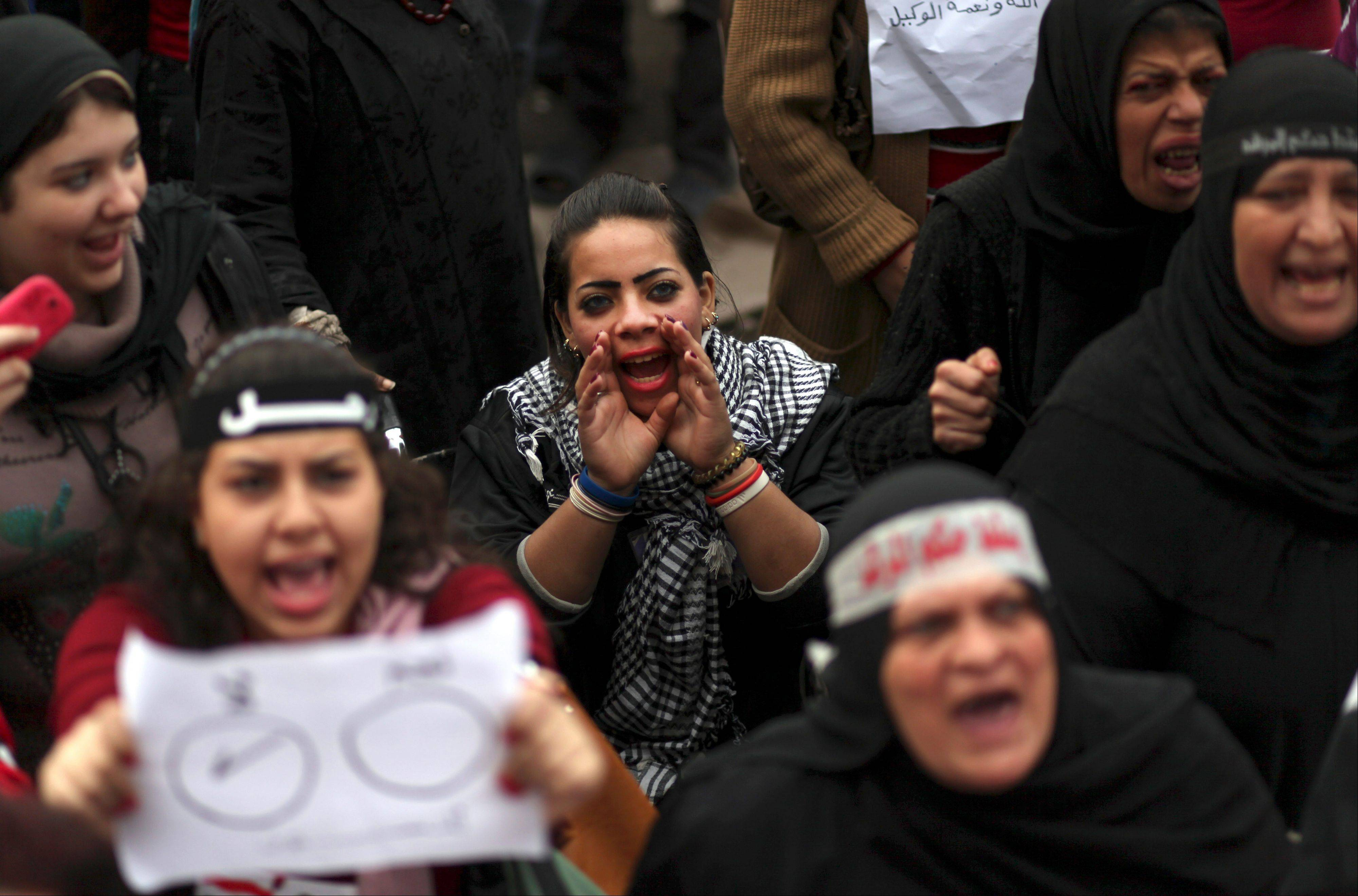 Egyptian protesters chant slogans as they attend a demonstration in Tahrir Square in Cairo, Egypt, Friday, Dec. 14, 2012. Opposing sides in Egypt�s political crisis were staging rival rallies on Friday, the final day before voting starts on a contentious draft constitution that has plunged the country into turmoil and deeply divided the nation.