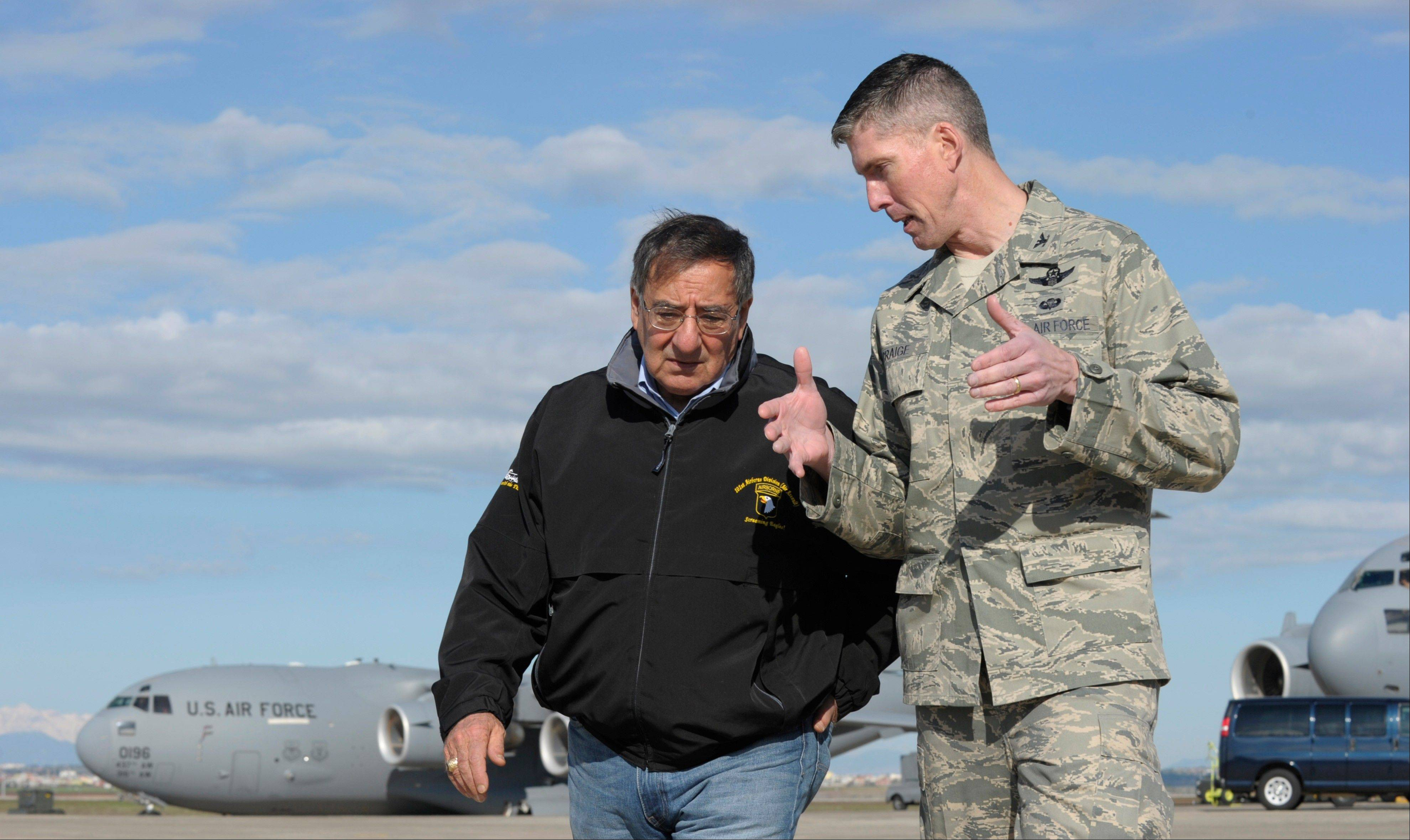 Defense Secretary Leon Panetta, left, talks with Col. Christopher E. Craige, Commander of the 39th Air Base Wing at Incirlik Air Base, Turkey, Friday, Dec. 14, 2012. Panetta stopped to visit troops in Turkey before heading home after spending three days in Afghanistan.