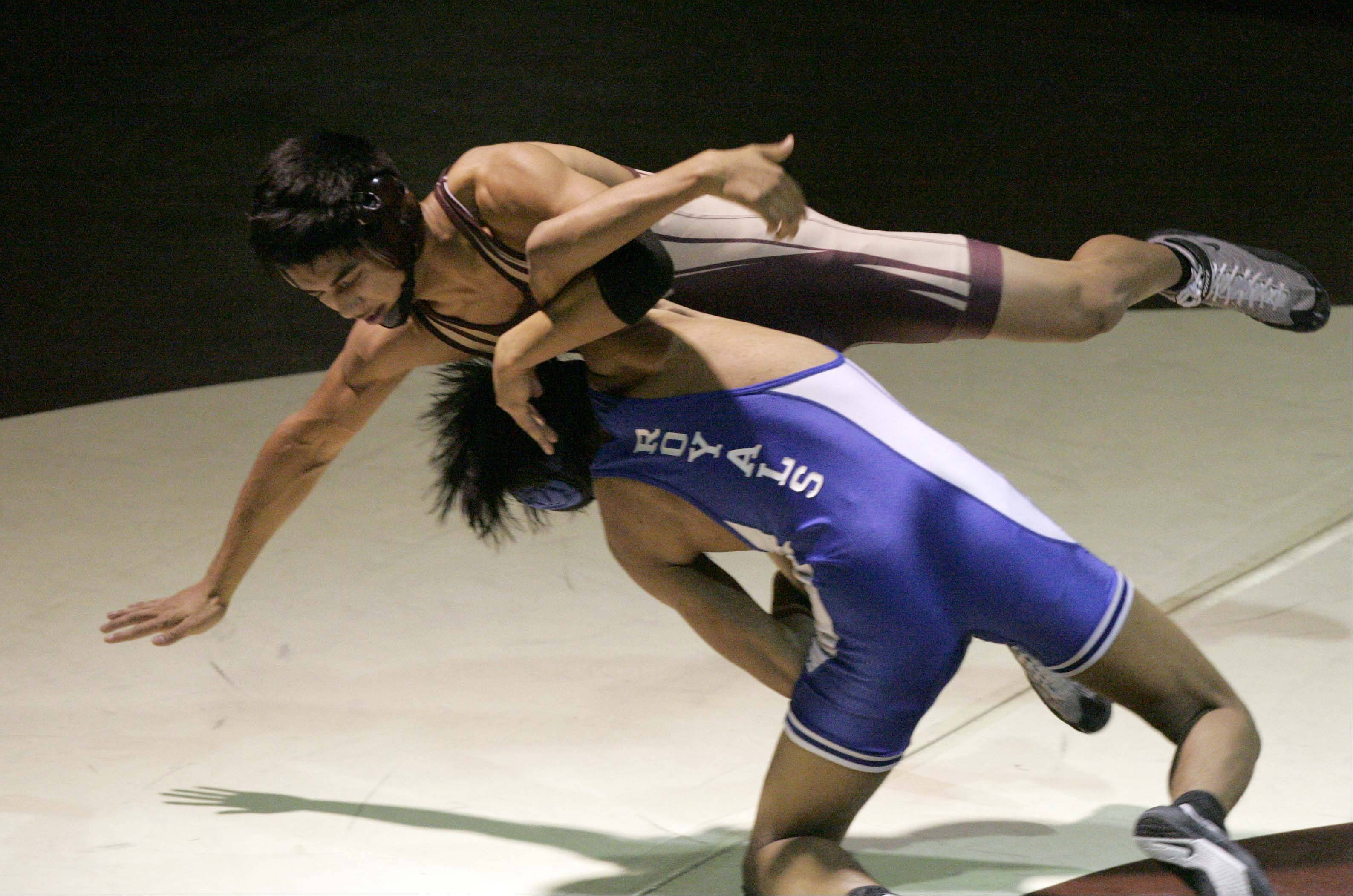 Larkin�s Francisco Calderon wrestles Elgin�s Nathan Romero at 132 pounds at Elgin High School Friday. Romero won the match.