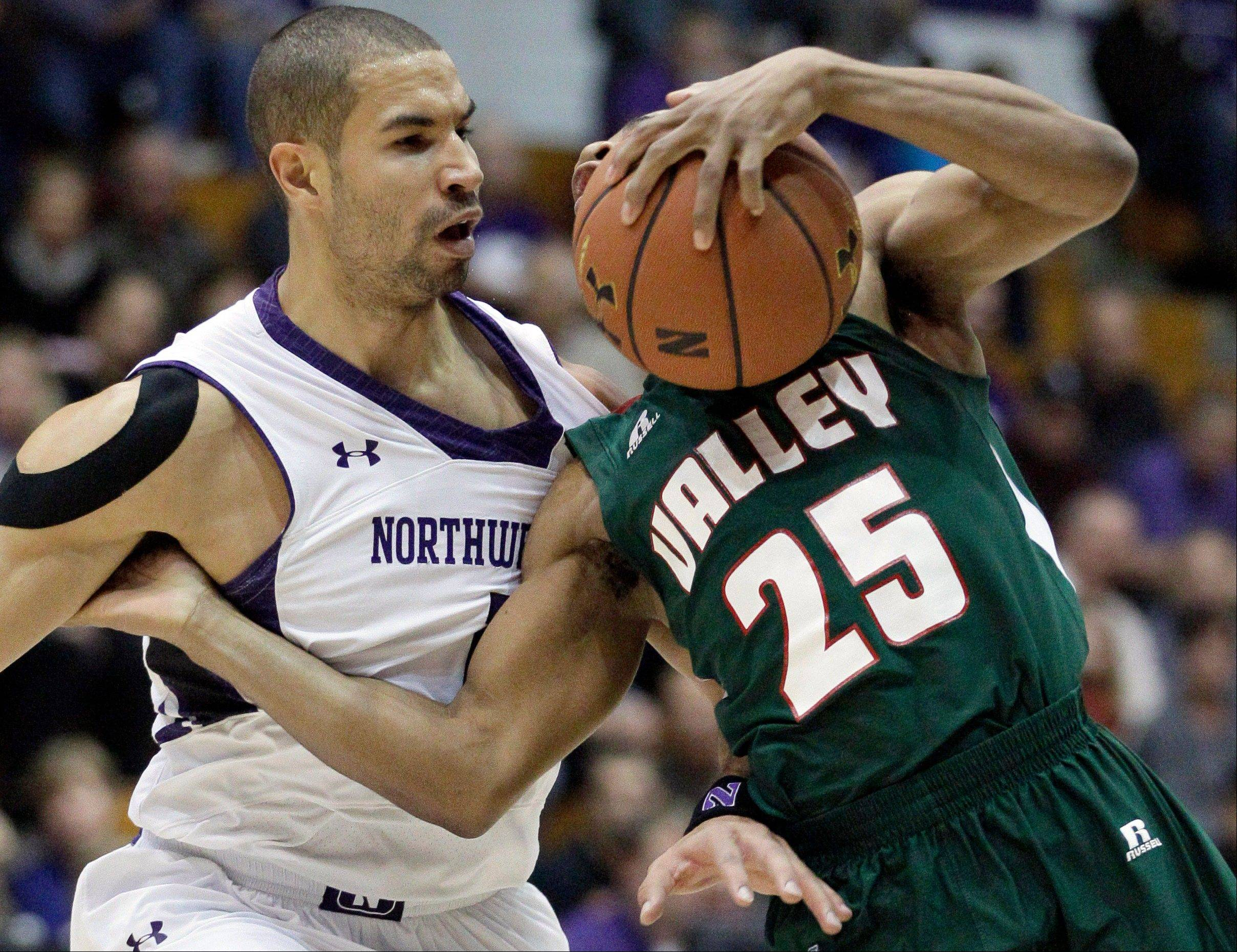 Northwestern forward Drew Crawford, left, will have surgery on his right shoulder and miss the rest of the season. The senior from Naperville Central was averaging more than 13 points per game for the Wildcats.