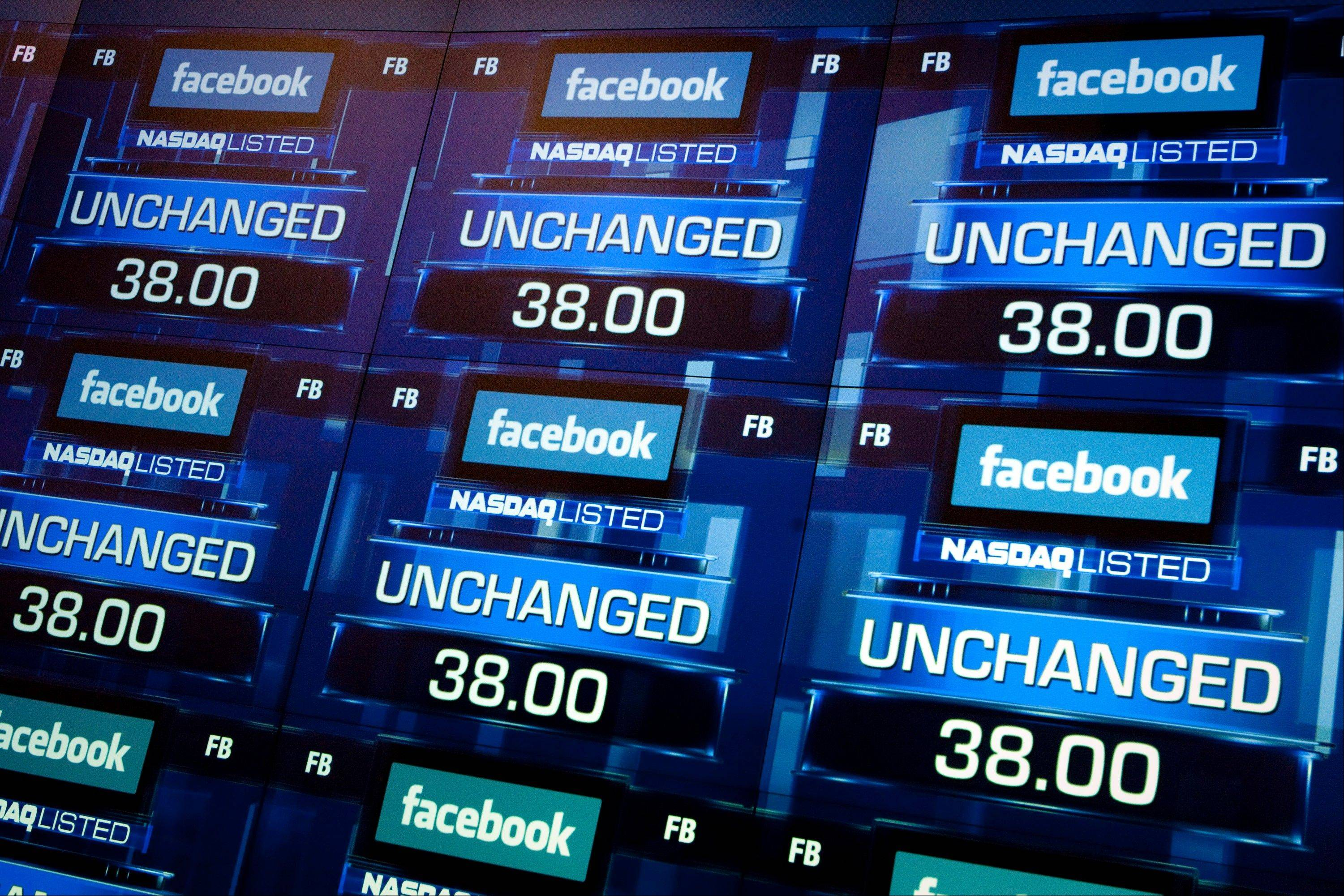 "The Facebook Inc. logo is displayed with the word ""unchanged"" prior to trading at the Nasdaq MarketSite in New York, U.S., on May 18, 2012."