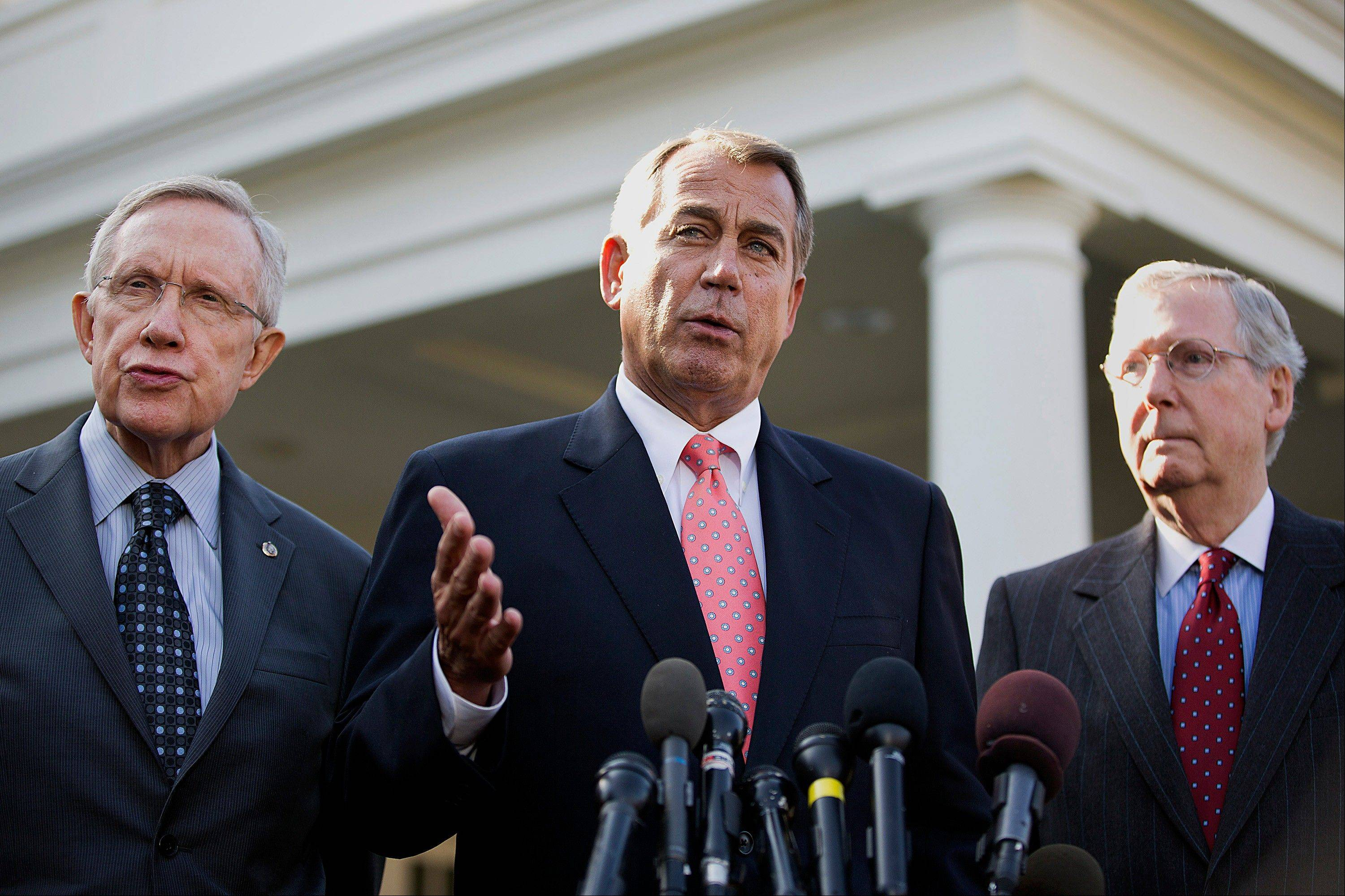 House Speaker John Boehner, a Republican from Ohio, center, speaks while Harry Reid, Democratic Senator from Nevada, left, and Mitch McConnell, Republican Senator from Kentucky, listen after meeting with U.S. President Barack Obama at the White House in Washington, D.C.