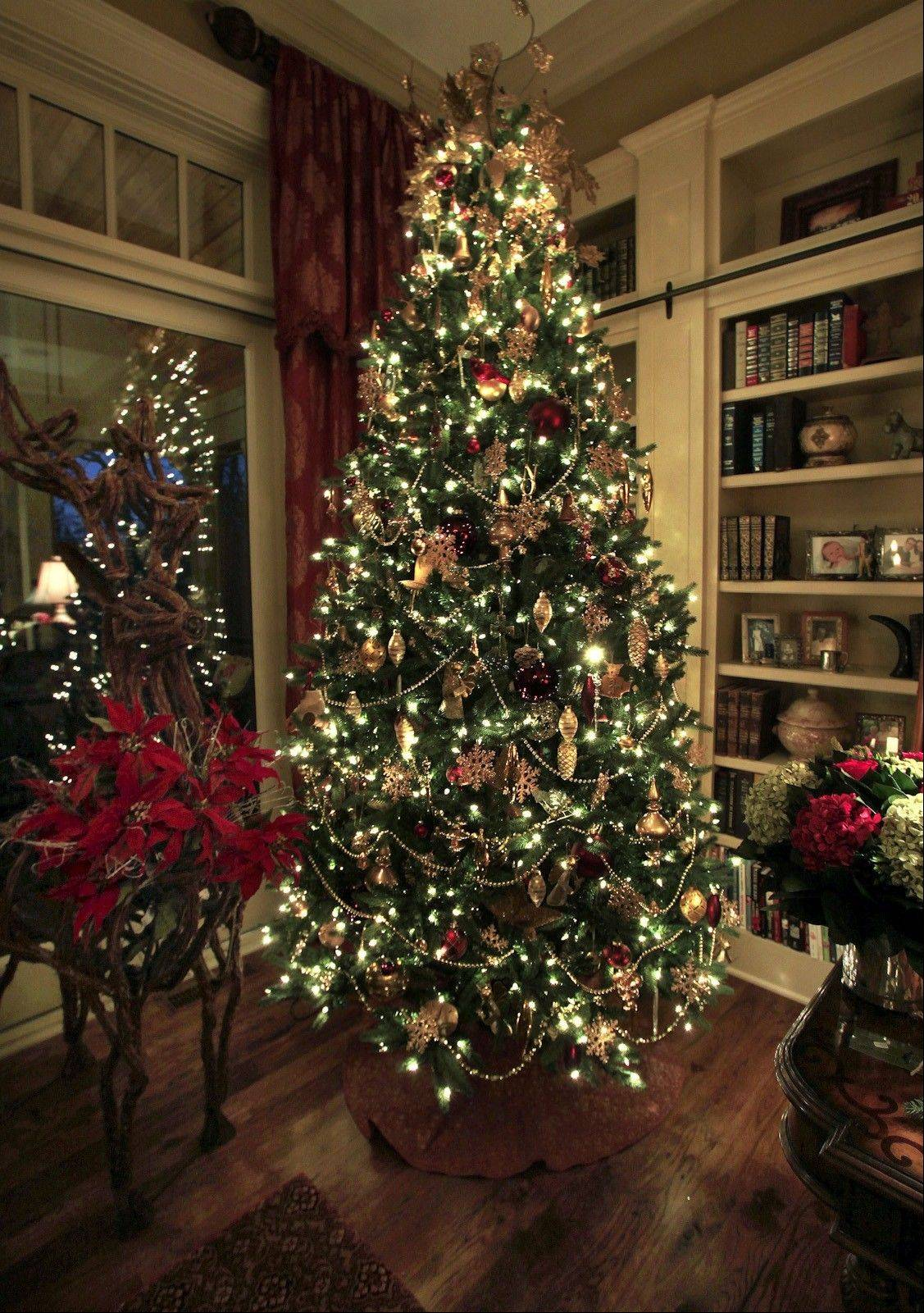 Homeowner Linda Pederson decorated her Christmas tree with burgundy and gold ornaments.