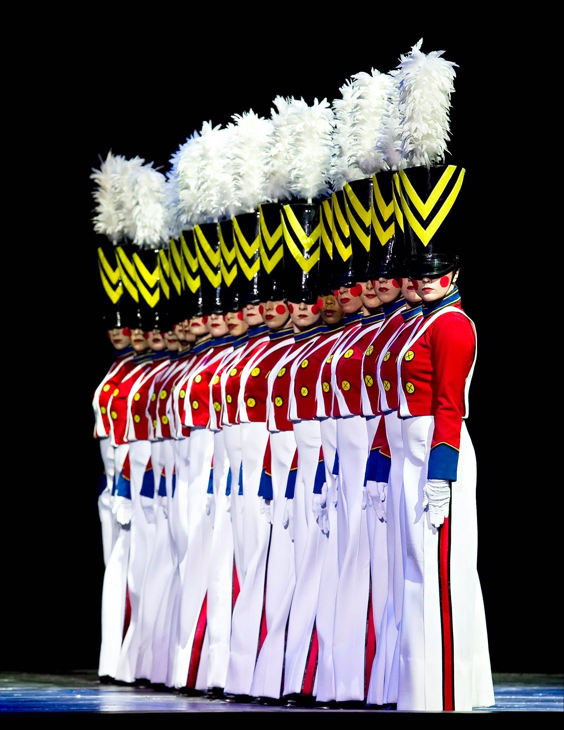 "The Rockettes perform their signature number ""Parade of the Wooden Soldiers"" during the ""The Radio City Christmas Spectacular"" at Rosemont's Akoo Theatre."