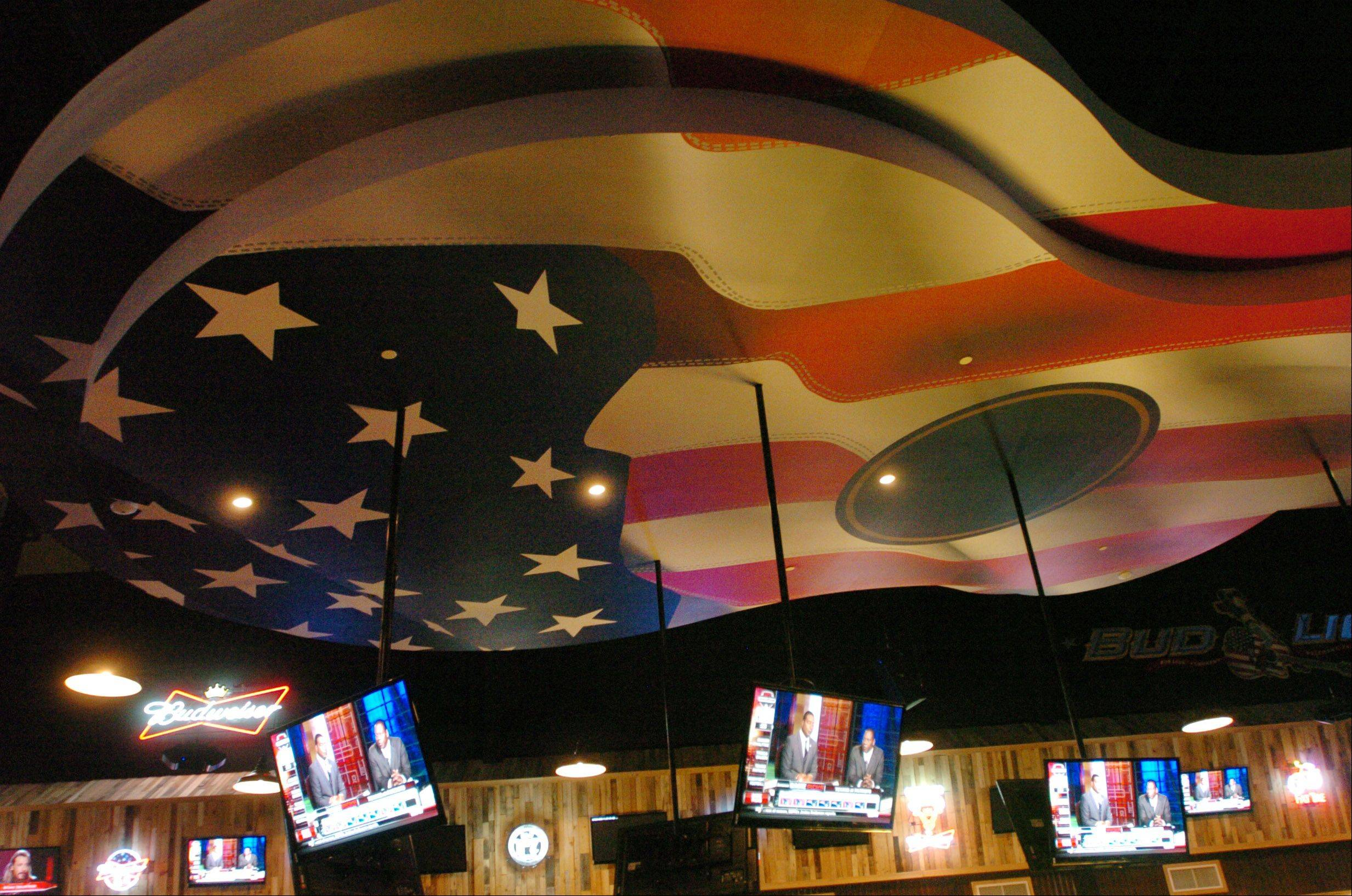 A giant guitar hangs from the ceiling of Toby Keith's I Love This Bar & Grill in Rosemont.