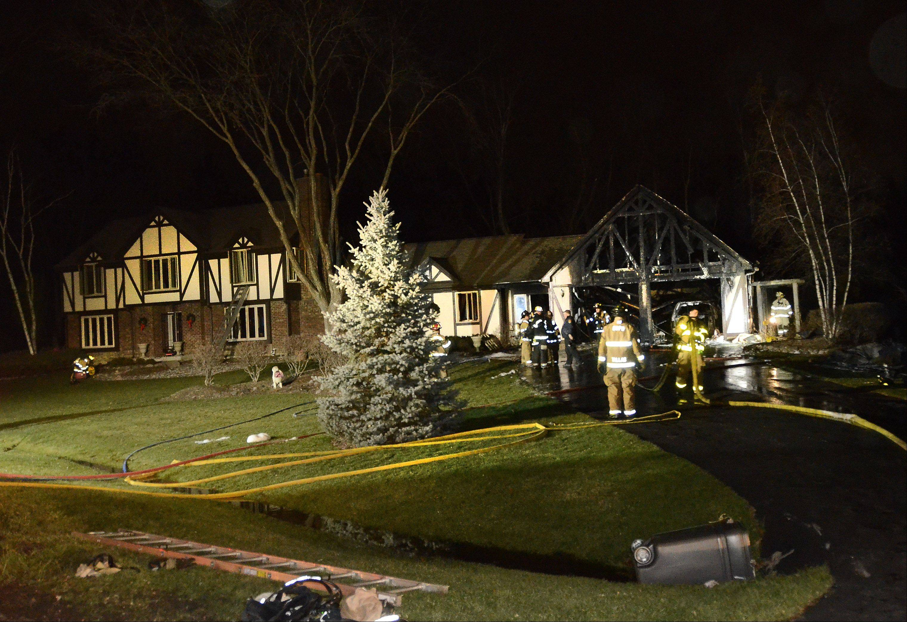 Fire burned an attached garage but left the house untouched on the 200 block of Knoxboro Lane near Barrington around 7 p.m. Friday.