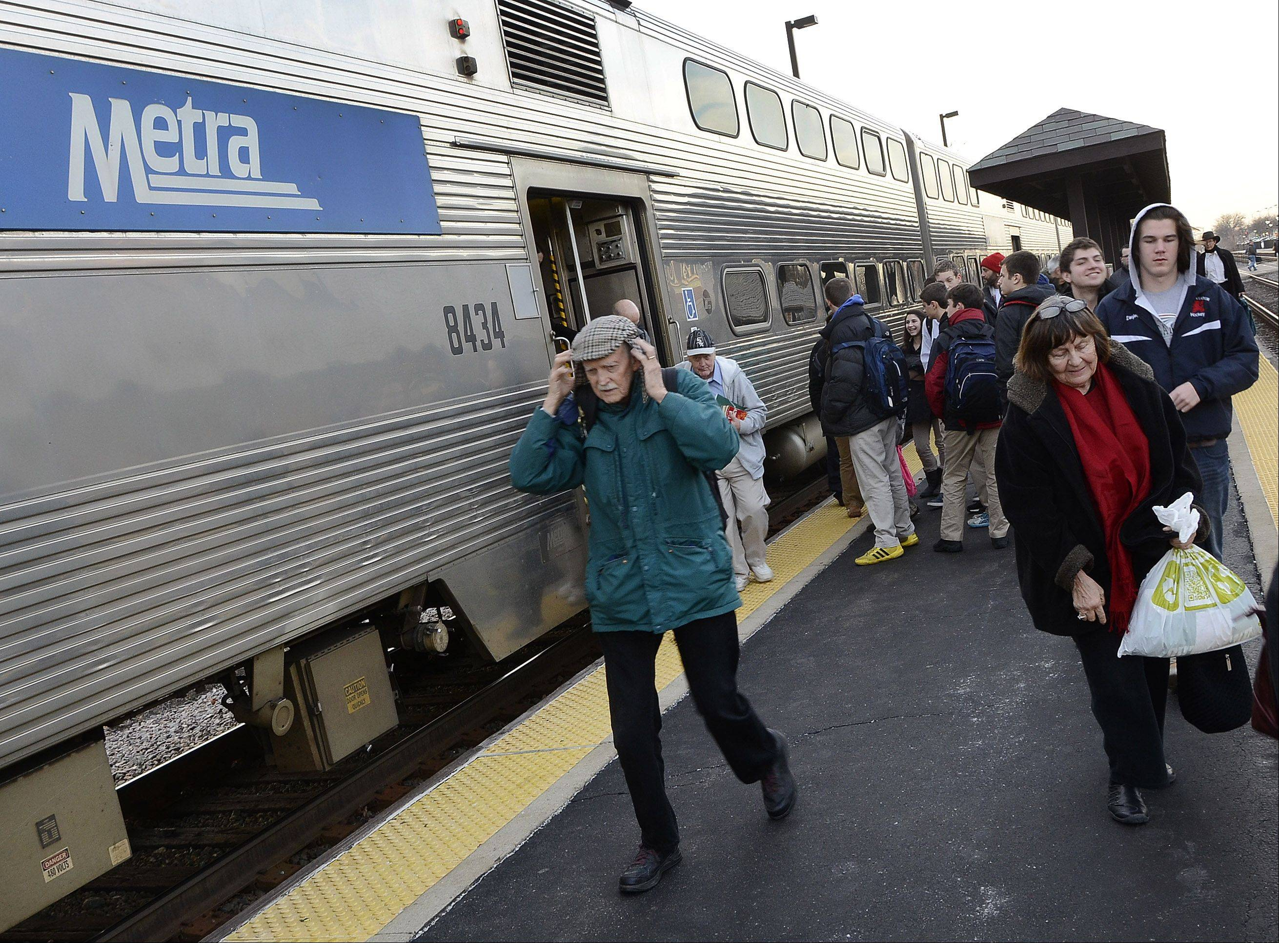 Metra commuters exiting the outbound train from Chicago at the Arlington Heights station Friday will see increases in 10-ride passes effective in February.