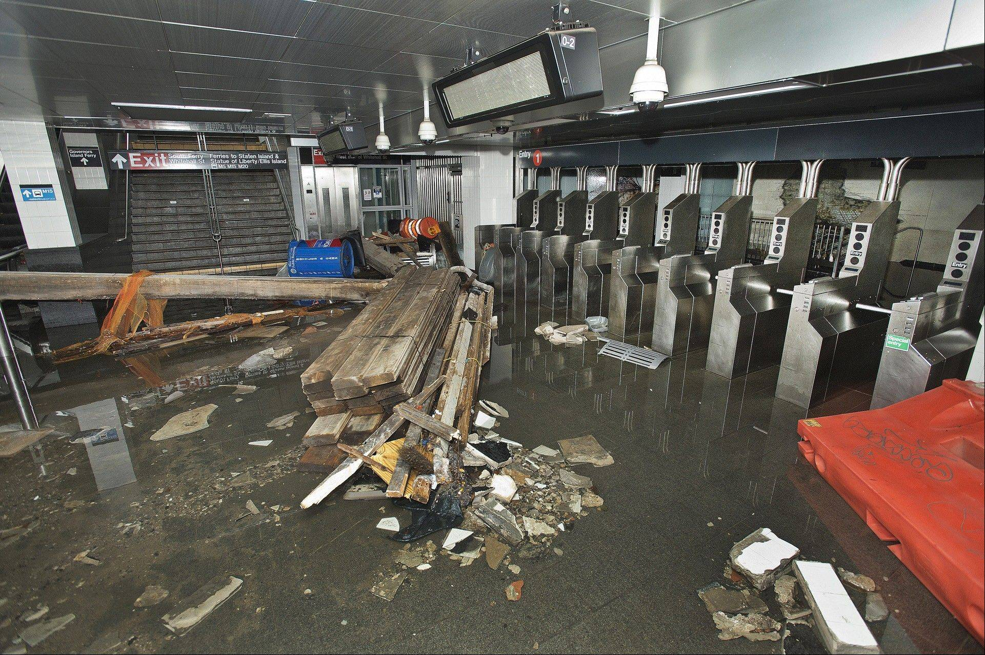 The South Ferry subway station in New York City is filled with seawater and debris from Superstorm Sandy.