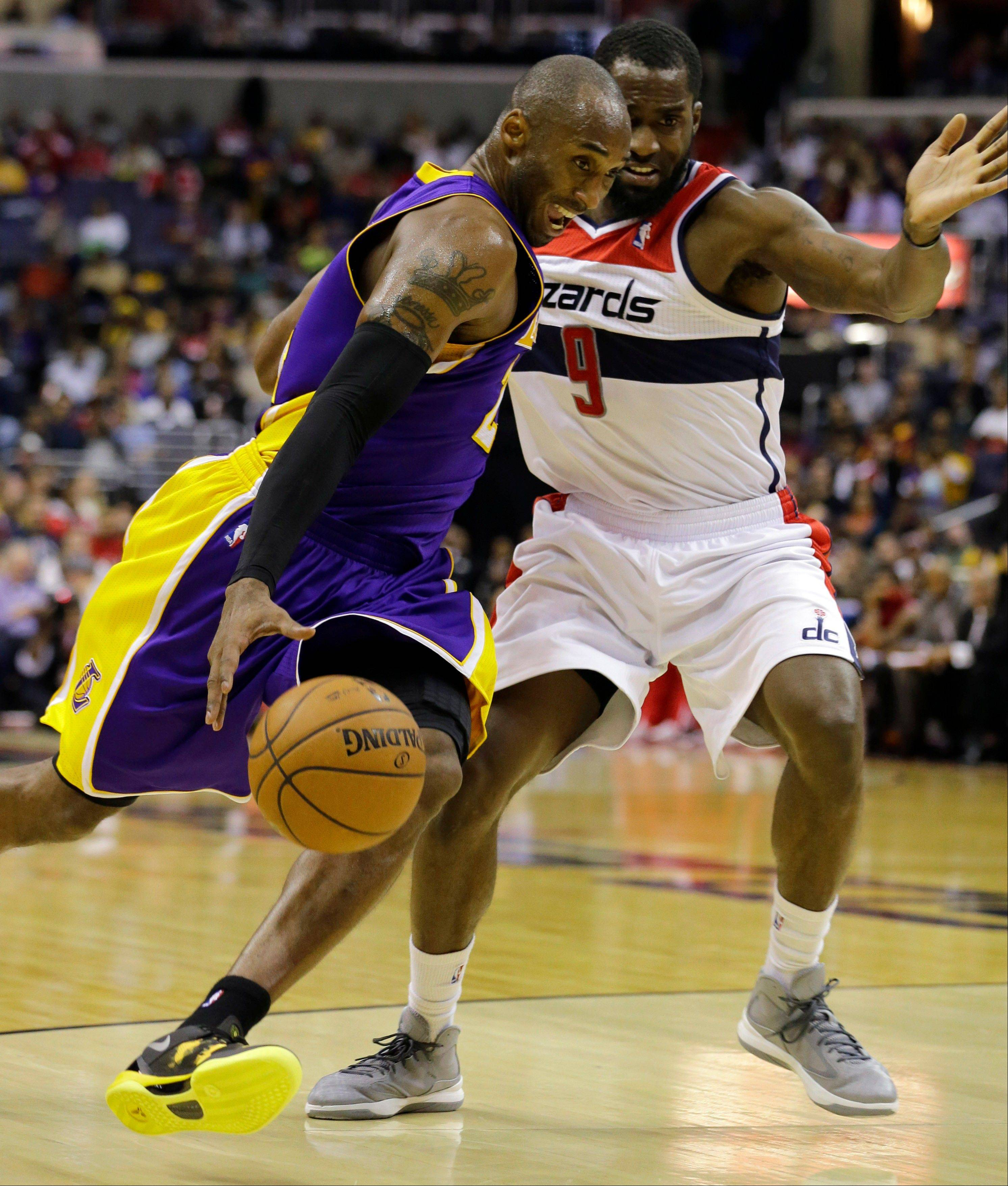 Los Angeles Lakers guard Kobe Bryant drives against Washington Wizards forward Martell Webster Friday during the first half in Washington.