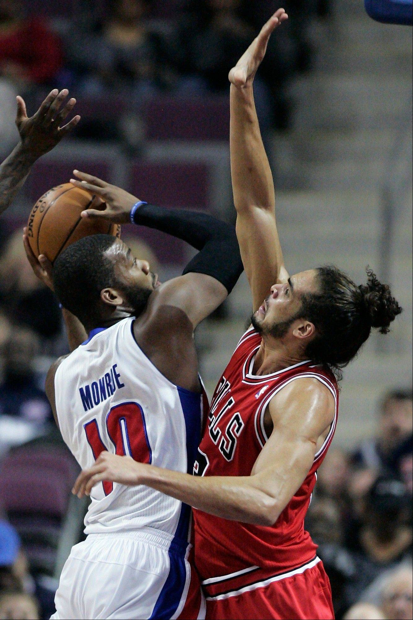 Detroit Pistons center Greg Monroe (10) tries going to the basket against Bulls center Joakim Noah during the first half in Auburn Hills, Mich.