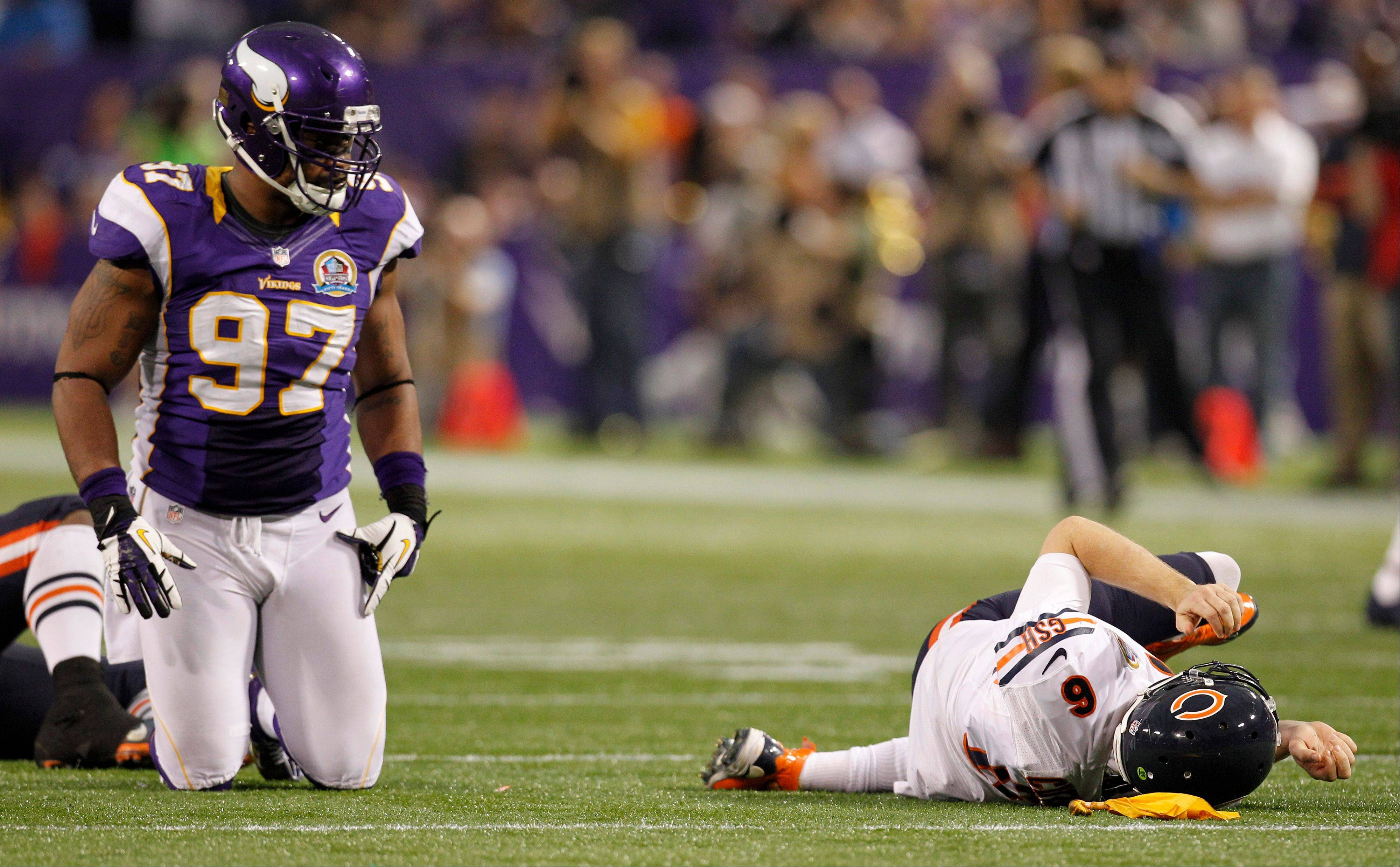Jay Cutler lays on the field Sunday after getting tackled by Minnesota Vikings defensive end Everson Griffen, left, during the second half in Minneapolis. Griffen was called for a personal foul on the play.