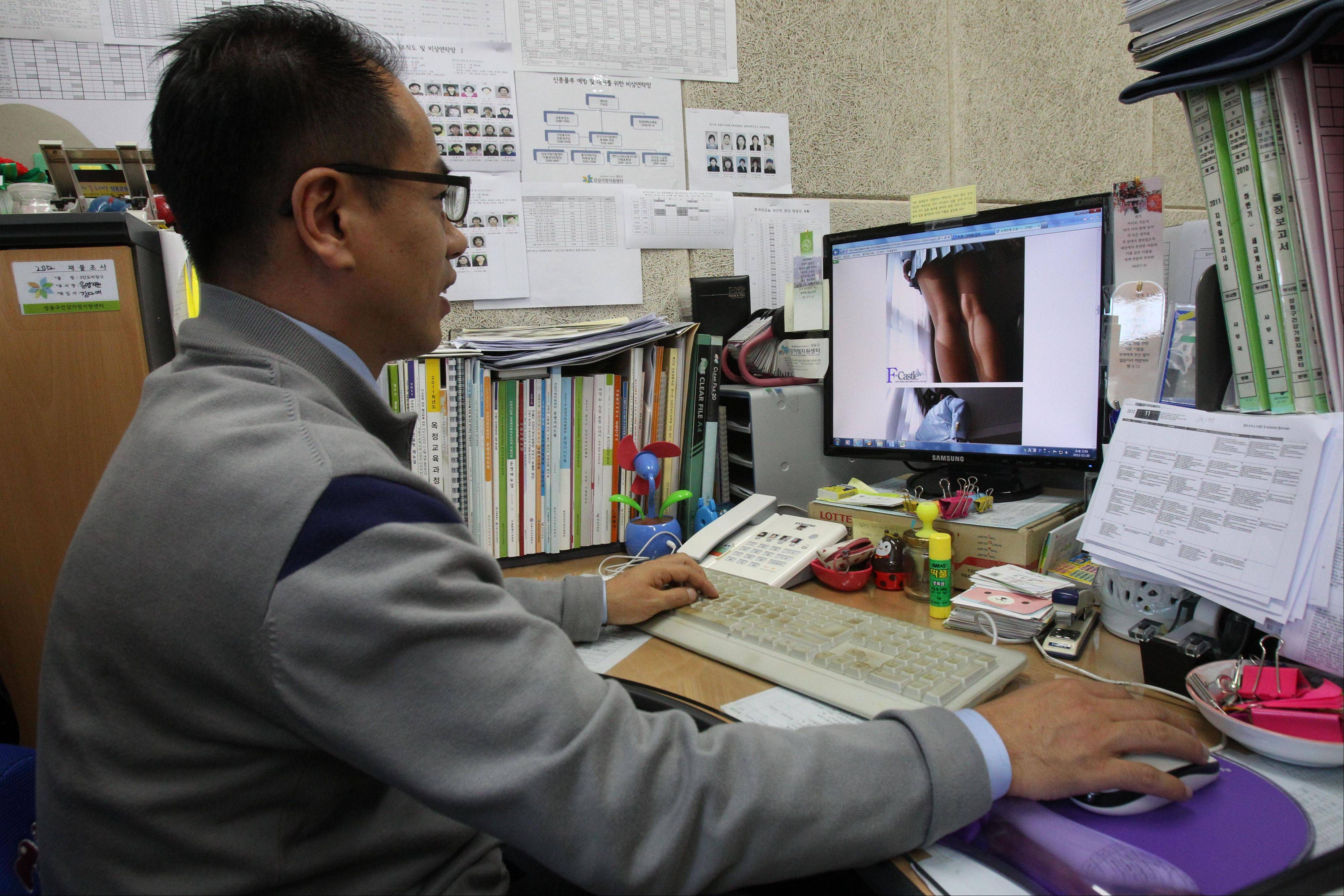 Moon Tae-hwa, a devout Christian and family counselor, uses a desktop computer to hunt down online pornography at his office in Seoul, South Korea. Moon is among the most successful members of the �Nuri Cops� (roughly �net cops�), a squad of nearly 800 volunteers who help government censors by patrolling the Internet for pornography in their spare time.