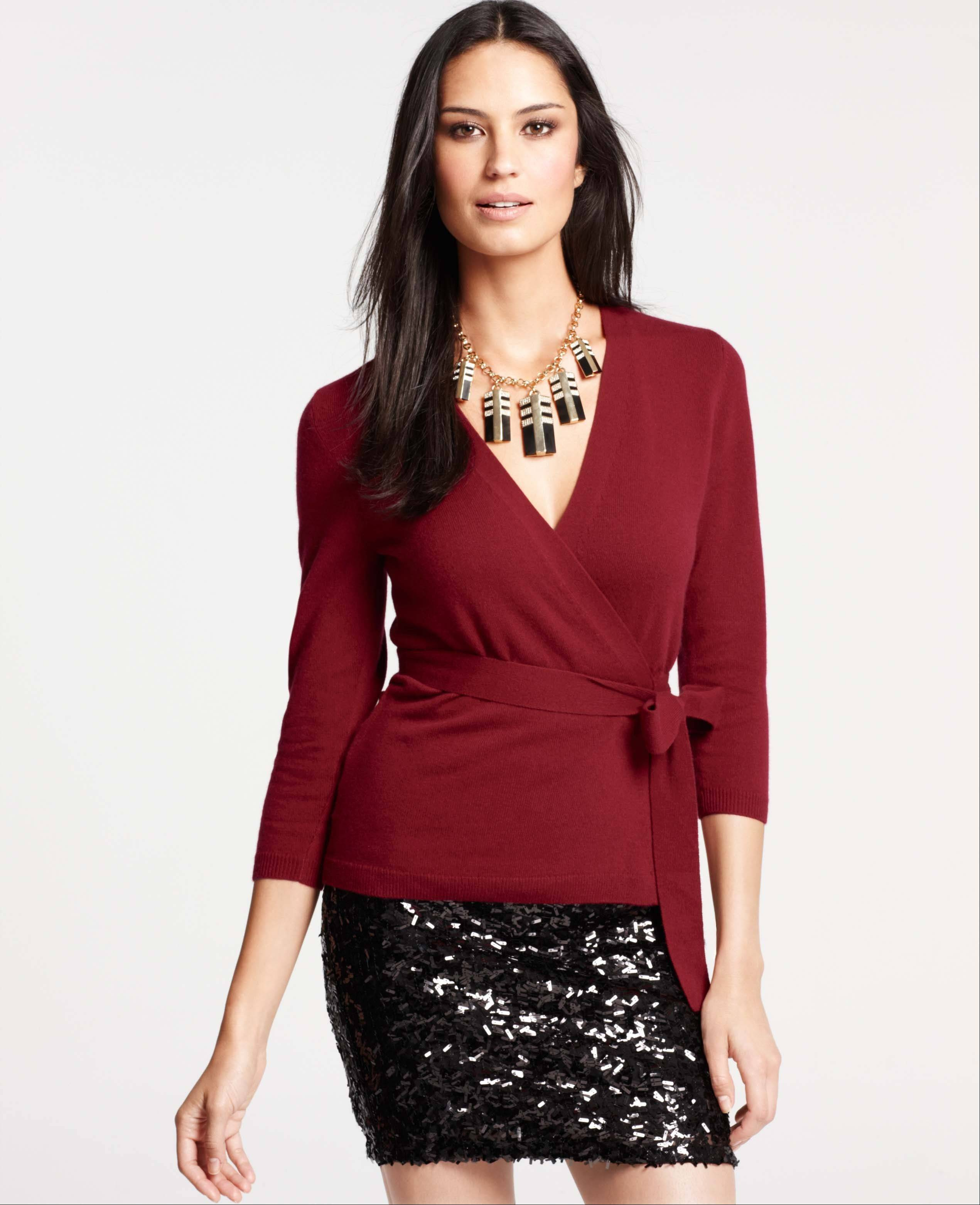 A cashmere wrap cardigan sweater and black sequin miniskirt makes a stylish statement for a party.
