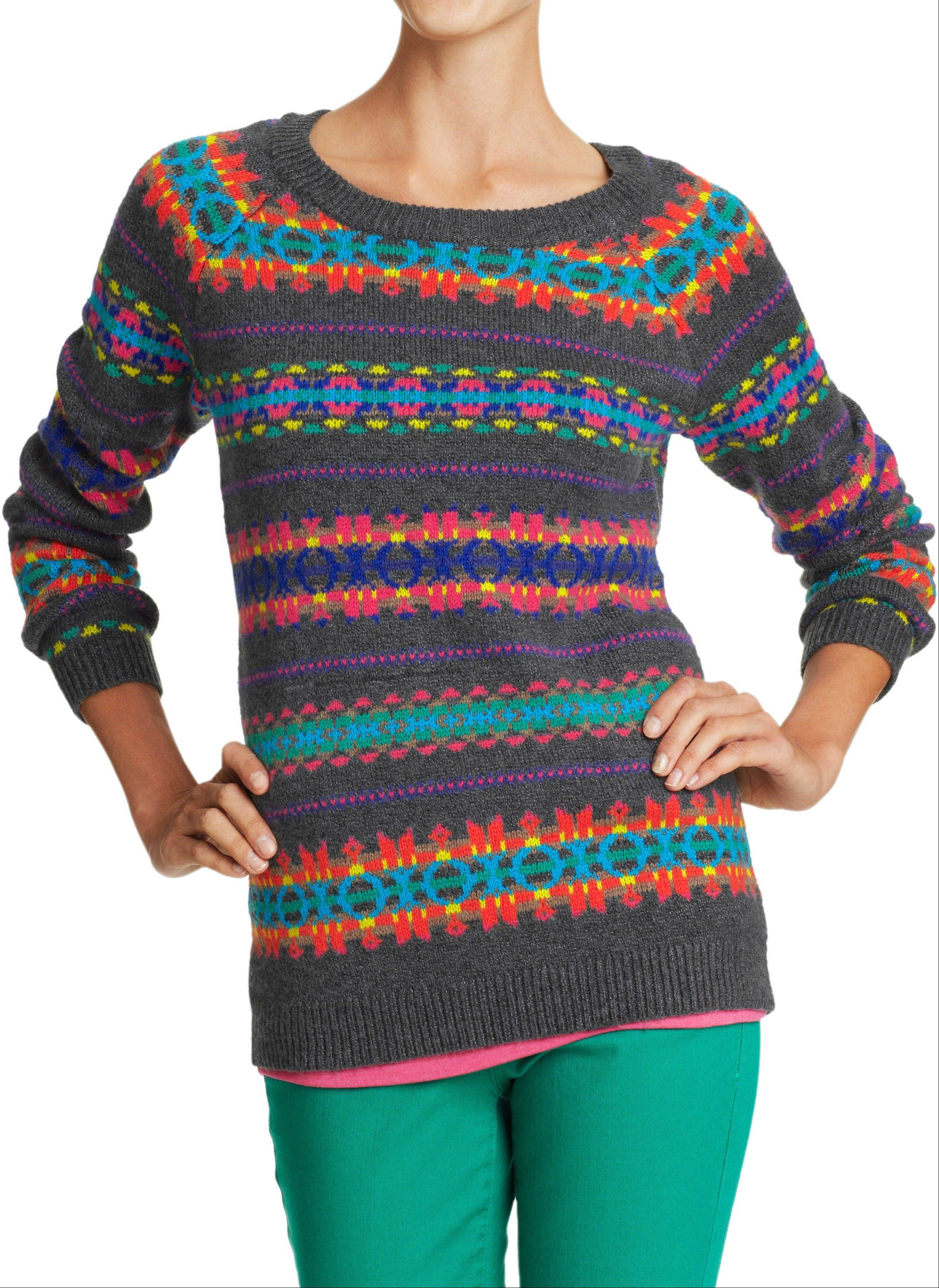 A a rib-knit crew neck, cuffs and hem sweater of soft, medium-weight cotton blend with an overall fair-isle-inspired pattern.
