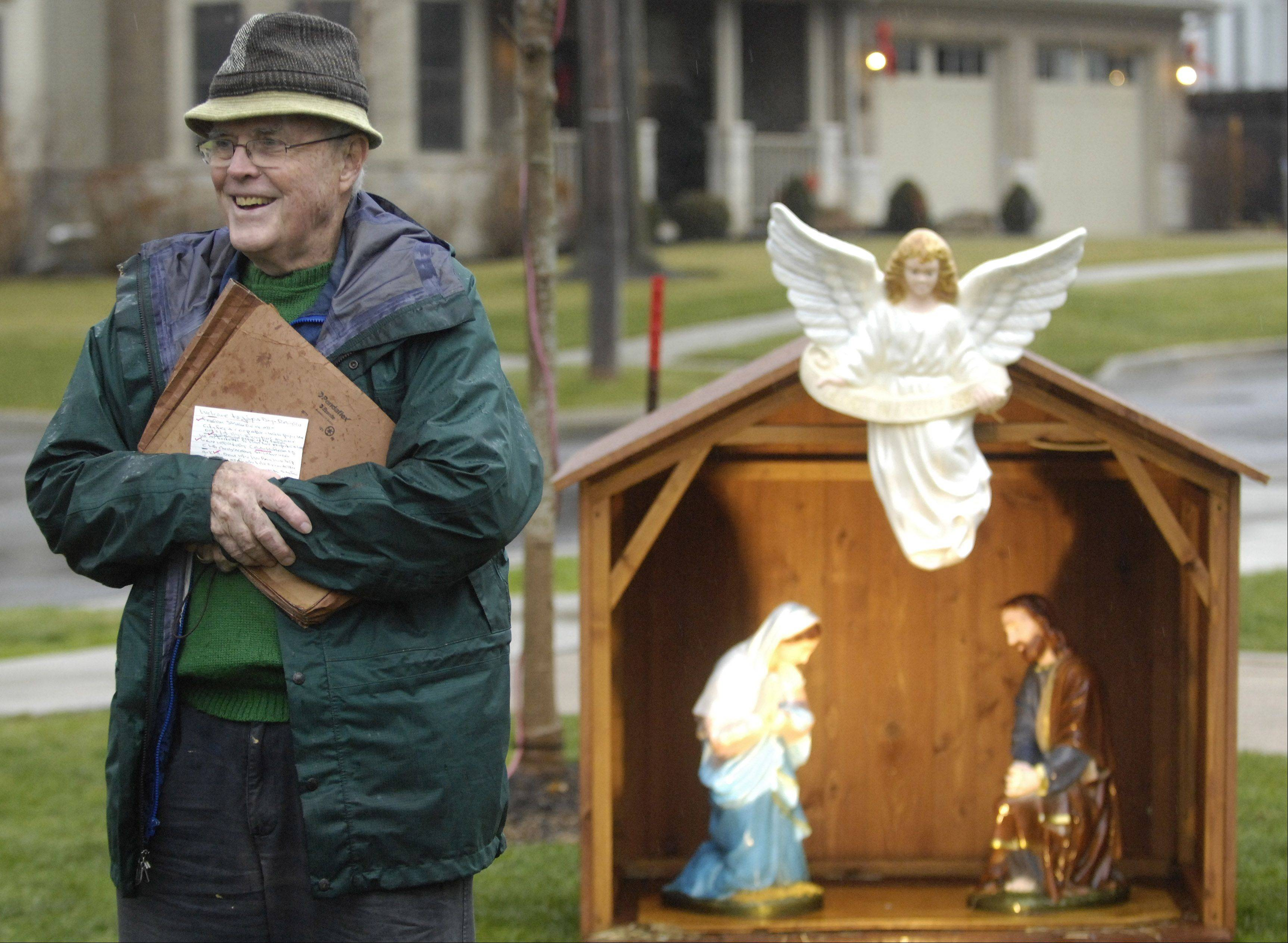 Jim Finnegan, director of the Illinois Nativity Scene Committee, speaks while standing in front of the Nativity scene added Saturday to the holiday lights displays at North School Park in Arlington Heights.