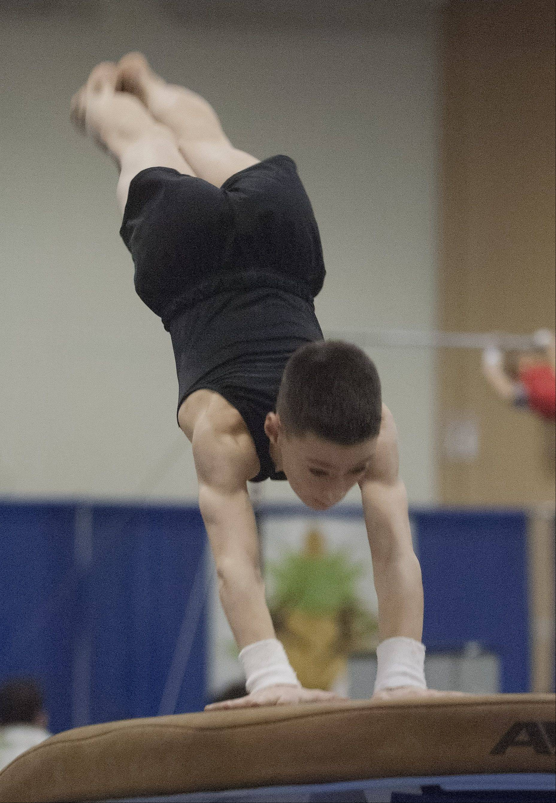 Skyler Chauff of the Buffalo Grove Gymnastics Center competes on the vault during the Hawaiian Pineapple Classic gymnastics meet, held at the Schaumburg Convention Center Saturday.
