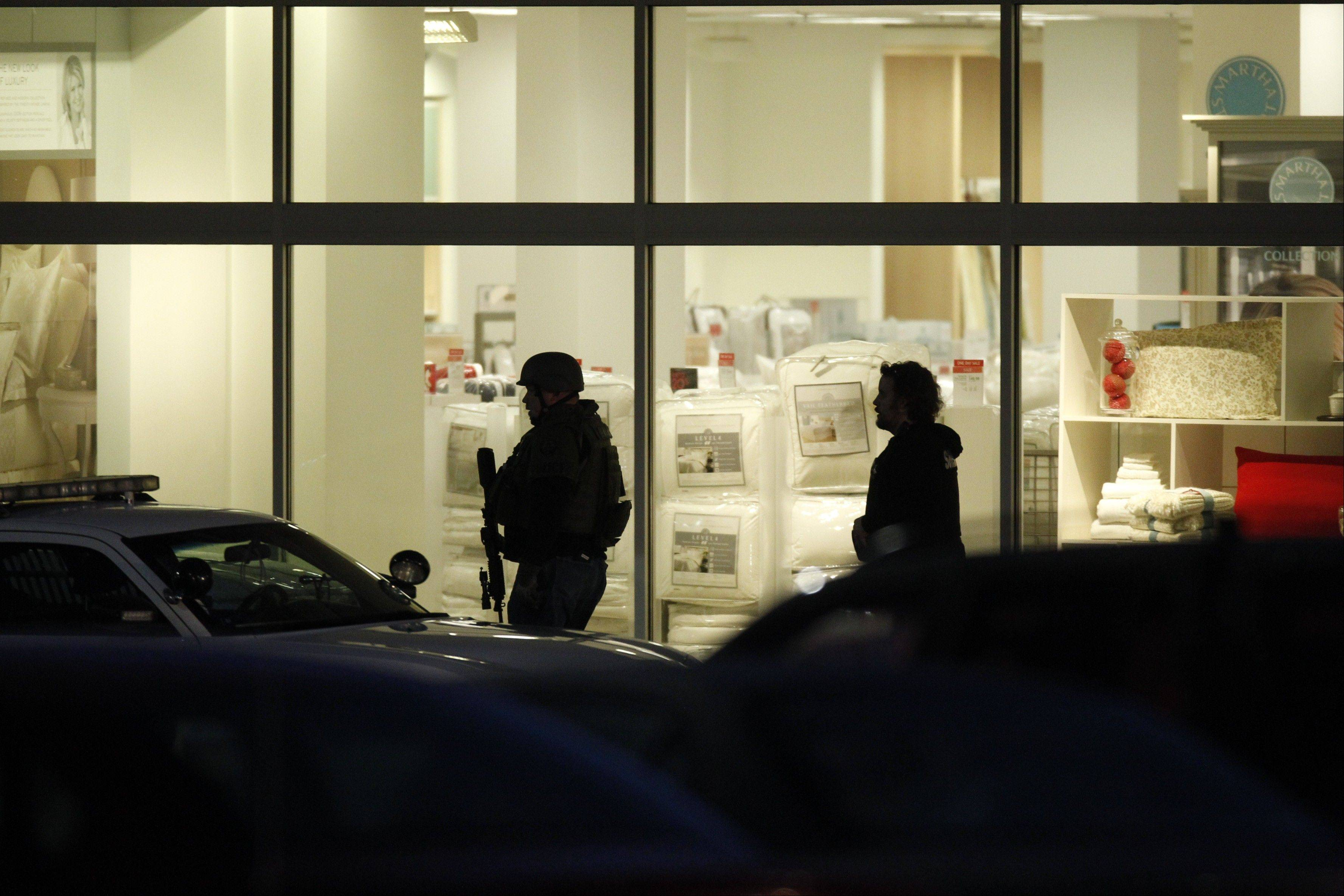 Law enforcement personnel work Tuesday at the scene of a shooting at the Clackamas Town Center mall in Clackamas, Ore. A gunman killed two people and wounded a third amid a holiday crowd estimated at 10,000 people.