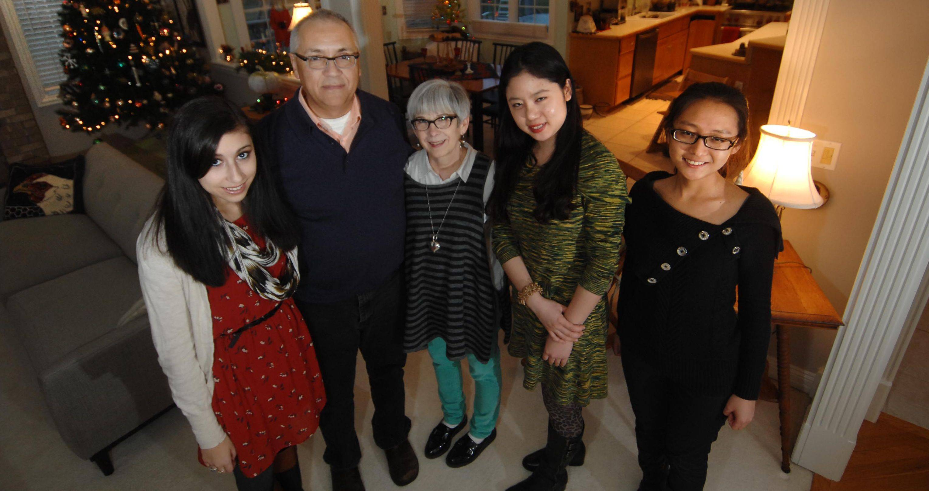 Xiaochen Wang, far right, and Rong Rong are the first two students in the Elgin Community College Homestay program. They are from Shanxi Normal University in China and are staying with ECC�s Elizabeth Reyes, the director of ECC�s Intensive English Program, and her daughter, Tegan, and husband, Robert.