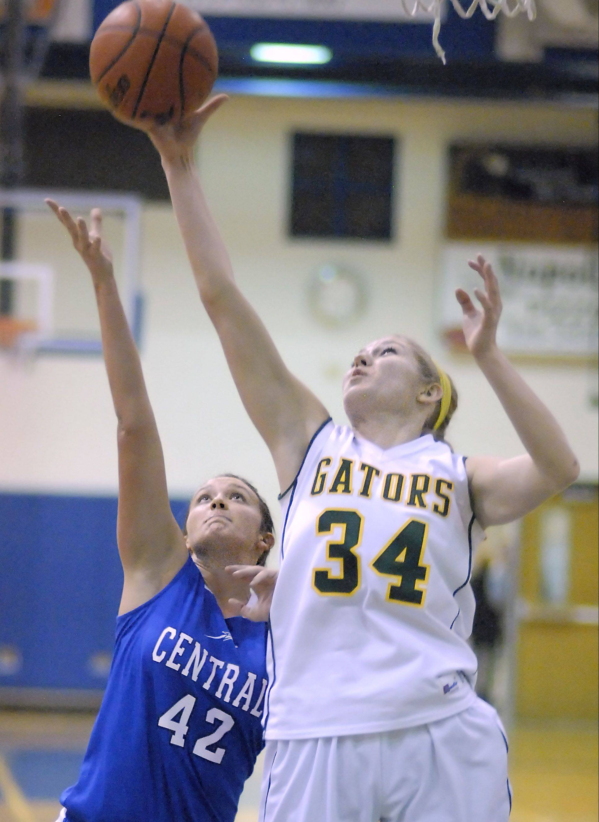 Burlington Central�s Alison Colby and Crystal Lake South�s Sara Mickow battle for a rebound Saturday during the Northern Illinois Holiday Classic at Woodstock.