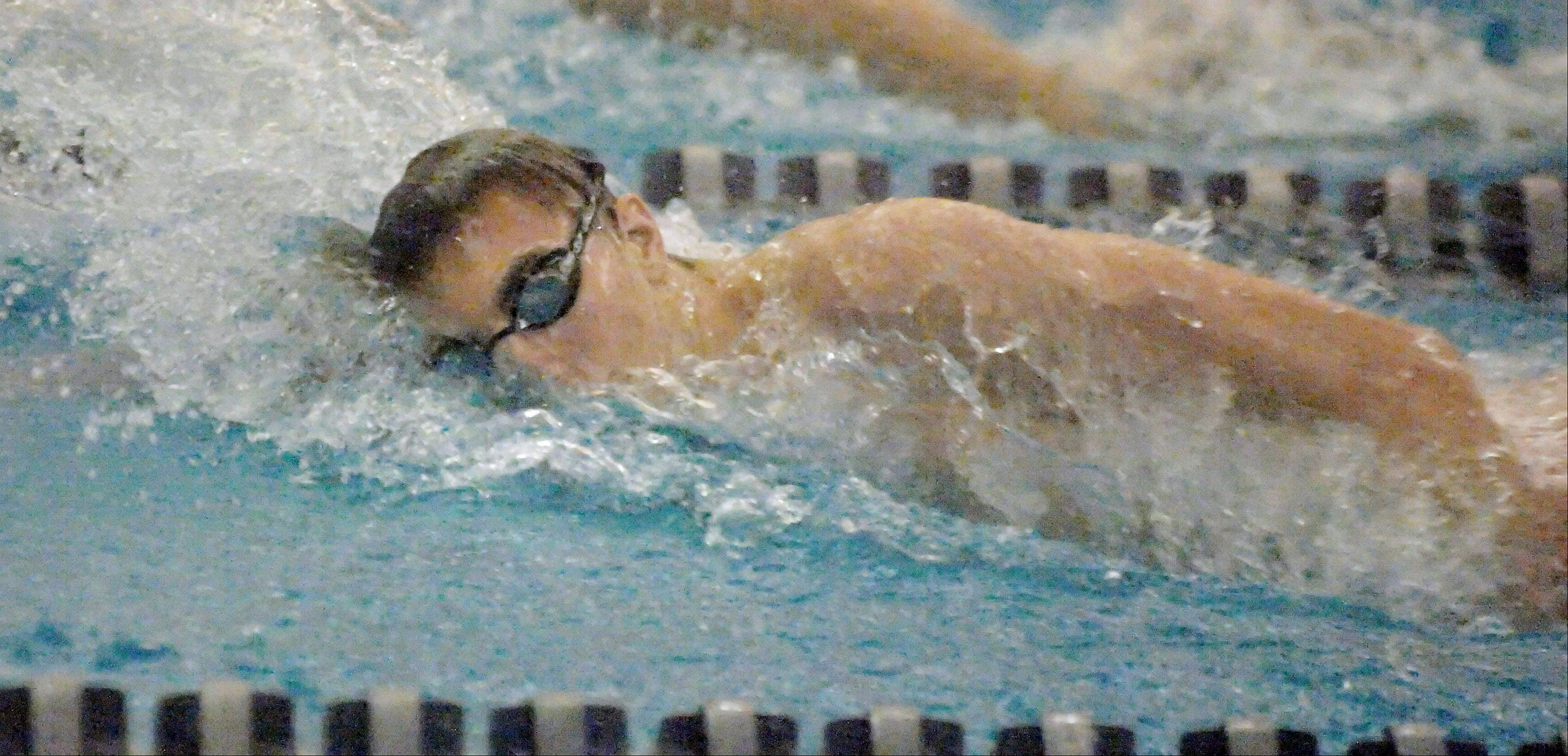 Eric Curia of Naperville North swims the 200 free during the Neuqua Valley boys swimming invitational Saturday.