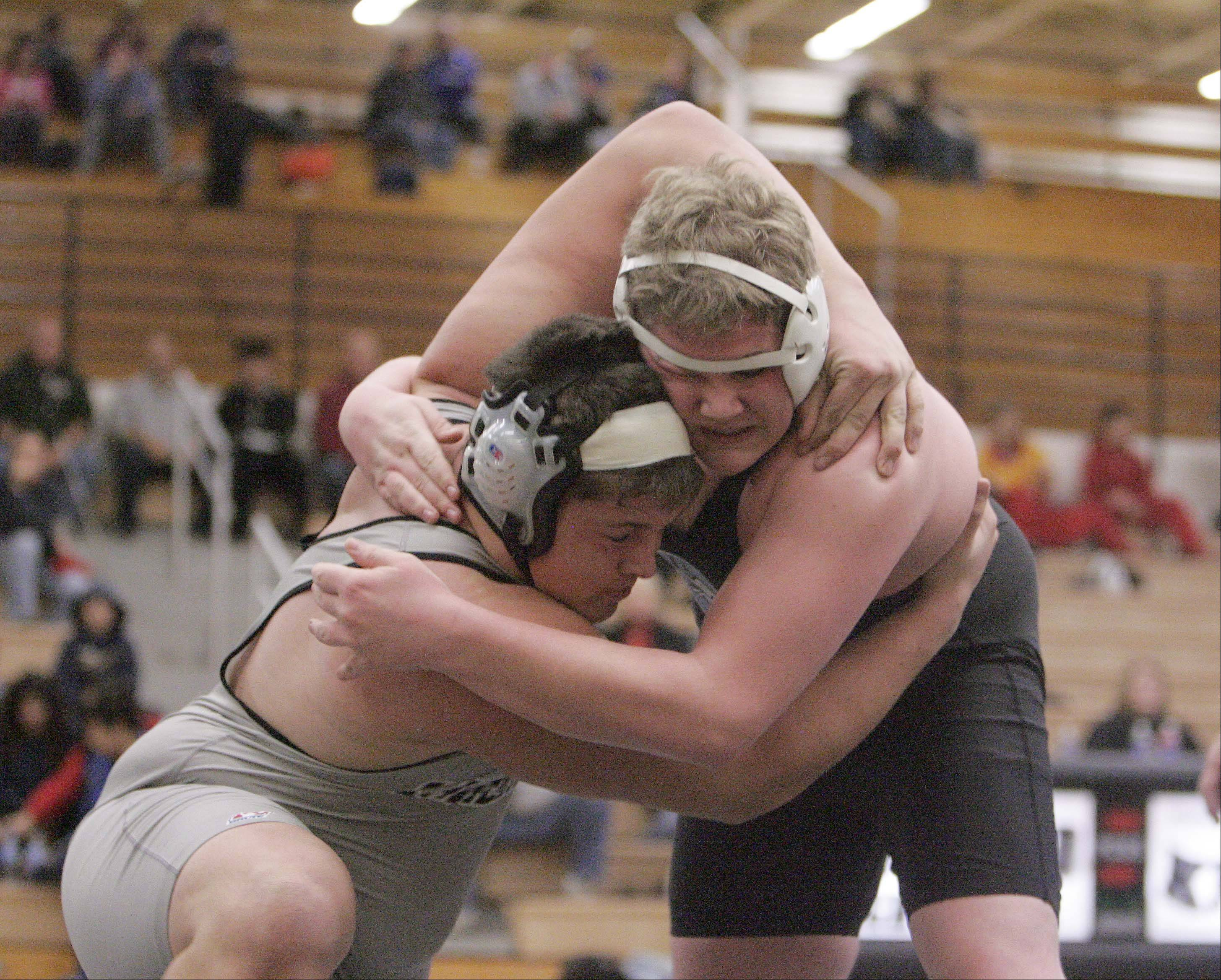 Kanelands�s Zach Theis wrestles Geneva�s Jake Anderson at 285 pounds during the Kaneland wrestling quad at Saturday December 15, 2012. Anderson won the match.