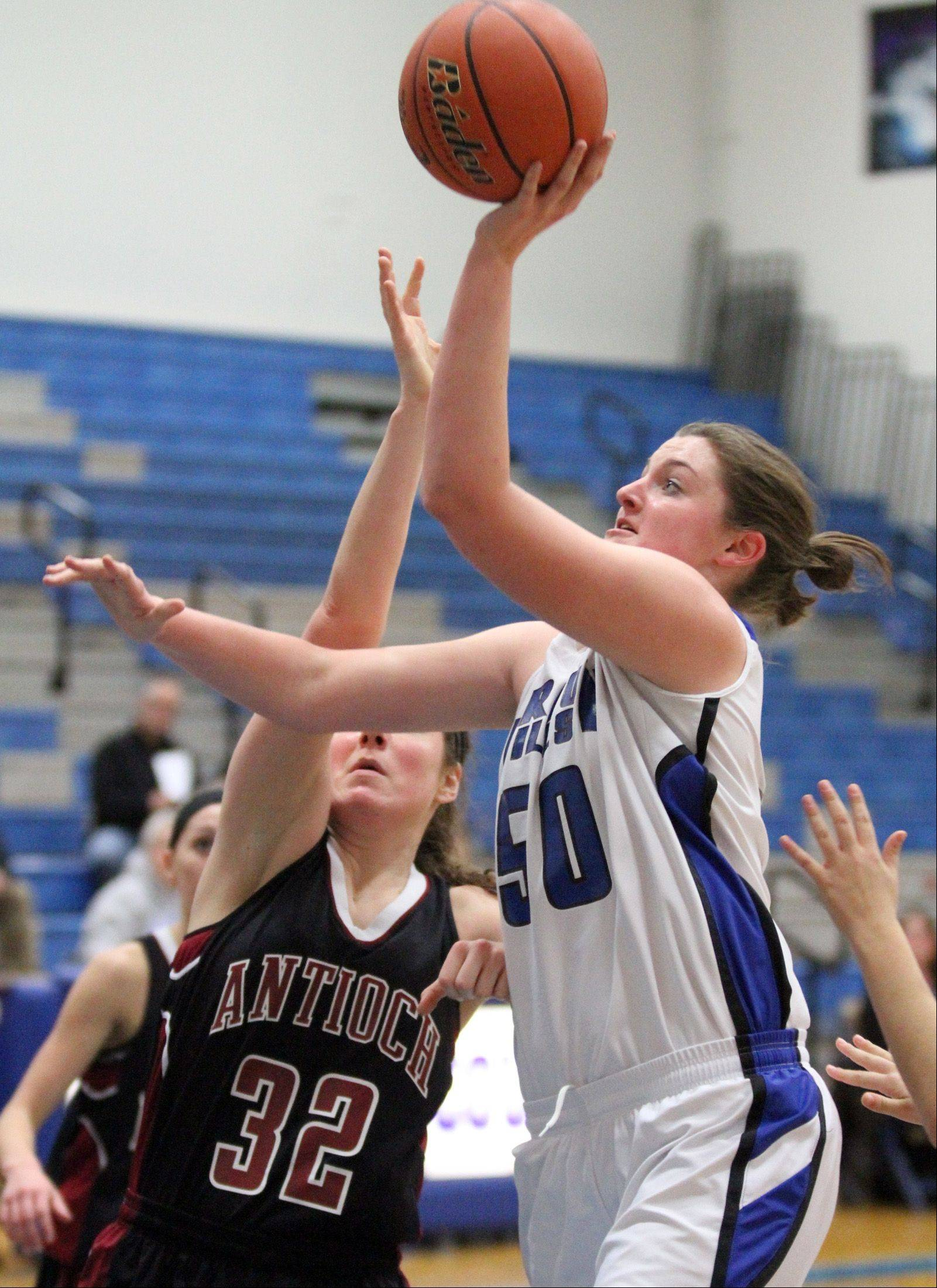 Vernon Hills� Meri Bennett-Swanson shoot over Antioch defender Alexandra Facek in Vernon Hills on Saturday, December 15.