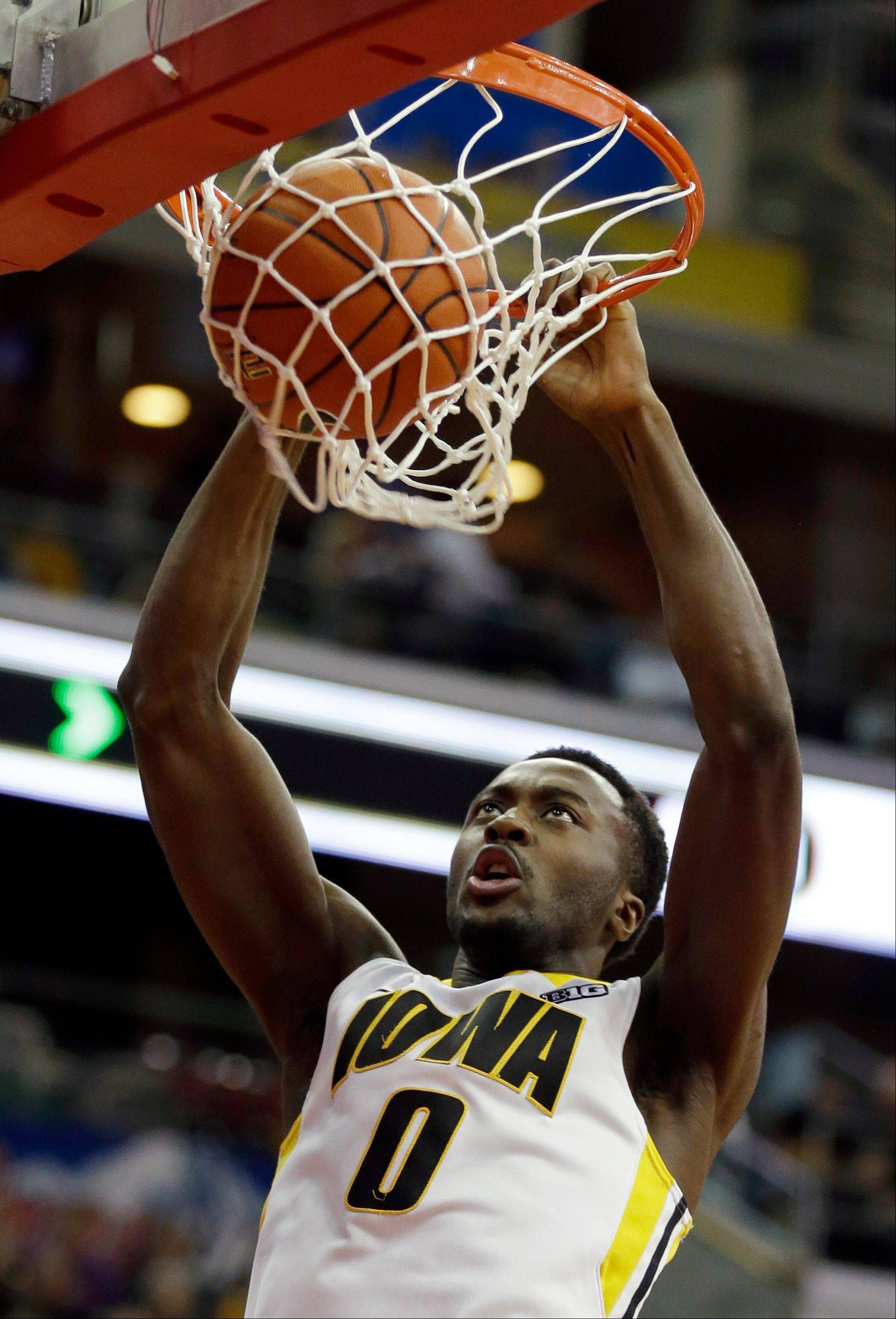 Iowa center Gabriel Olaseni dunks Saturday during the first half against Northern Iowain Des Moines, Iowa.