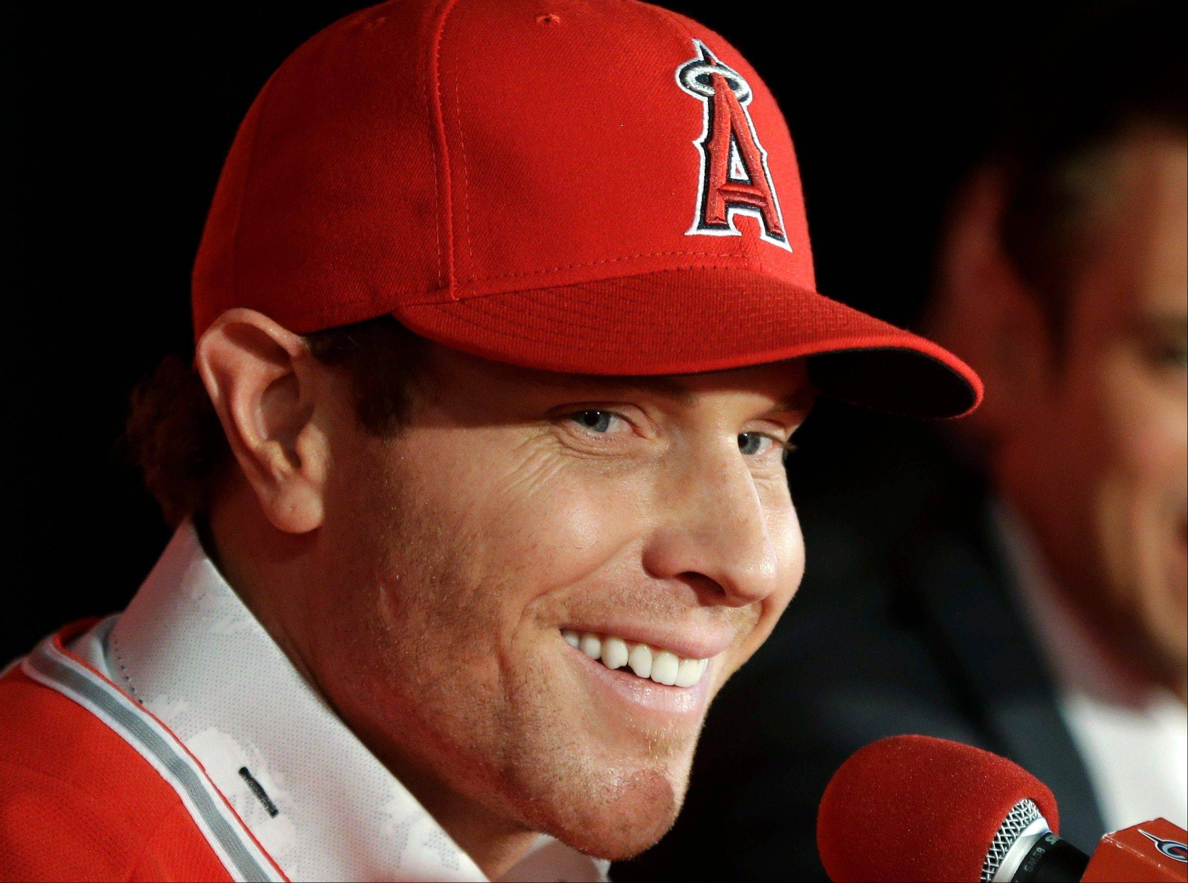 Free-agent outfielder Josh Hamilton talks to the media Saturday during a news conference in Anaheim, Calif. Hamilton, formerly of the Texas Rangers, joined the Los Angeles Angels after signing a $125 million, five-year contract.