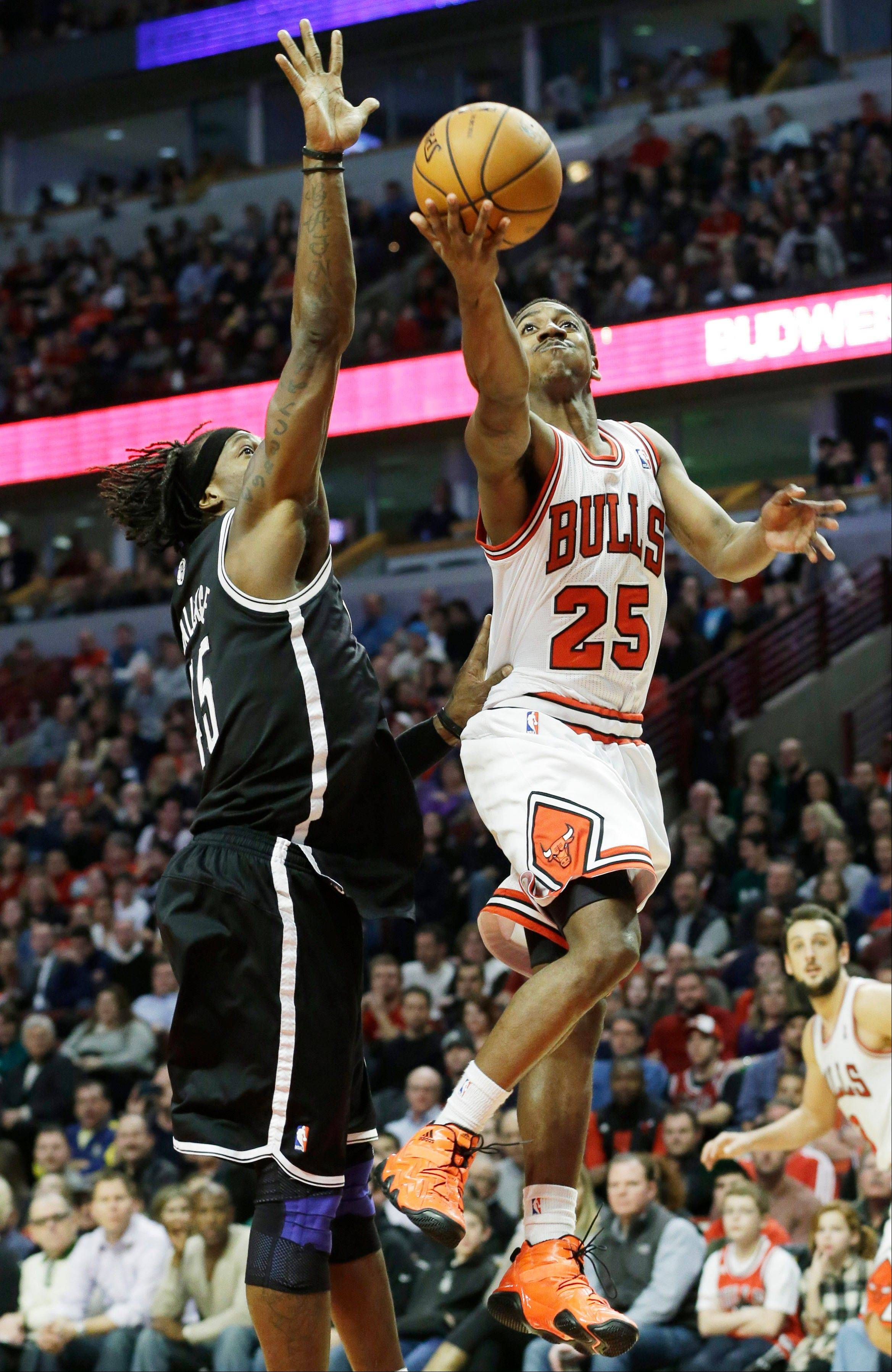 Marquis Teague, right, drives to the basket against Brooklyn Nets forward Gerald Wallace during the second half of an NBA basketball game in Chicago on Saturday, Dec. 15, 2012. The Bulls won 83-82.